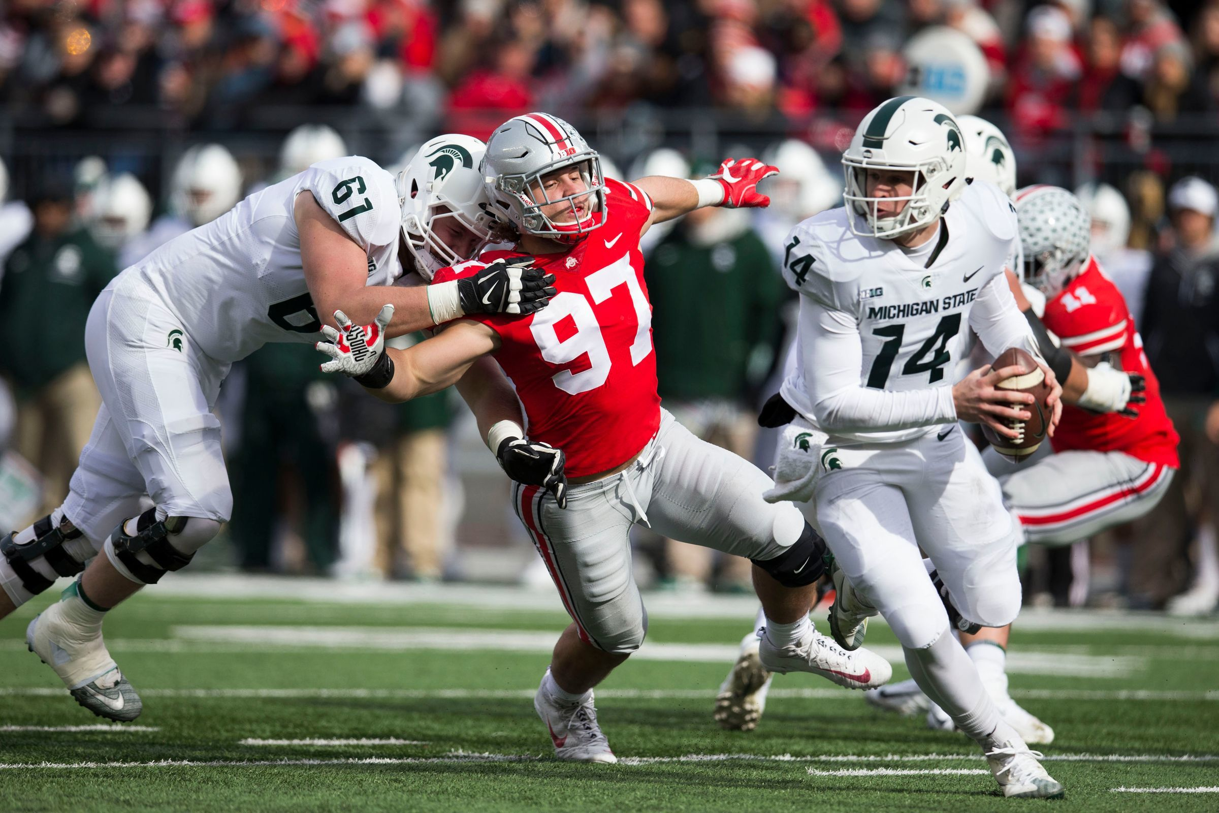 Brian Lewerke and Messiah deWeaver were sacked a combined six times in 2017's loss to the Buckeyes in Columbus.