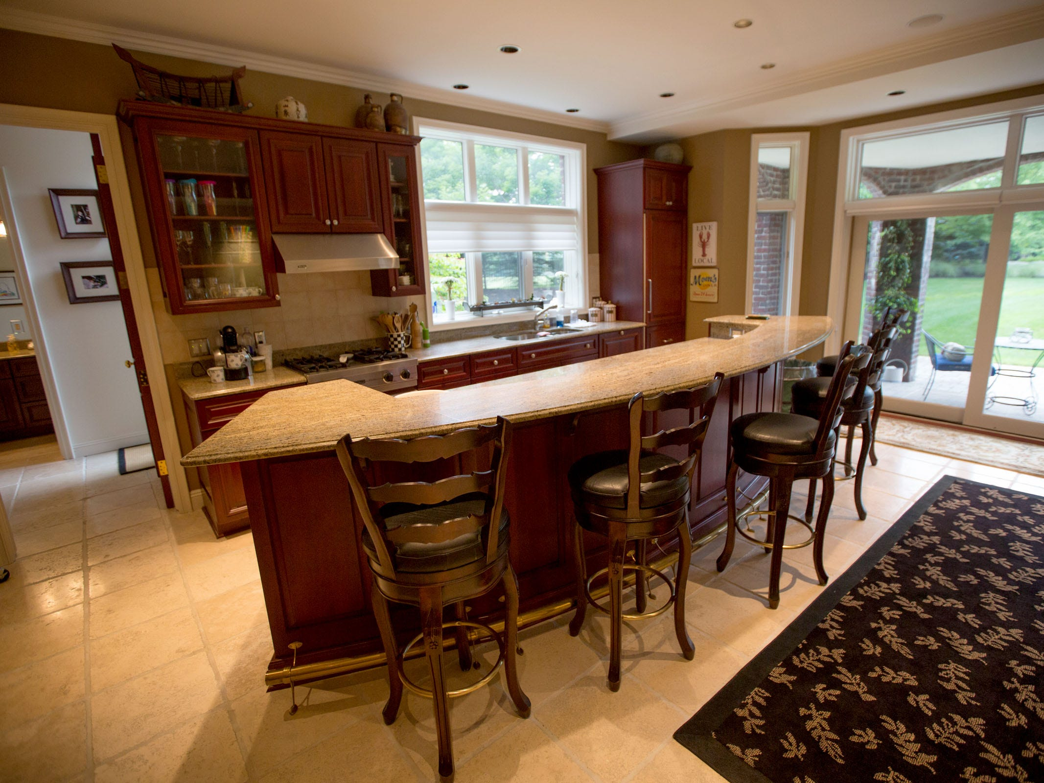 A second full kitchen with Viking appliances is part of the lower level party space.