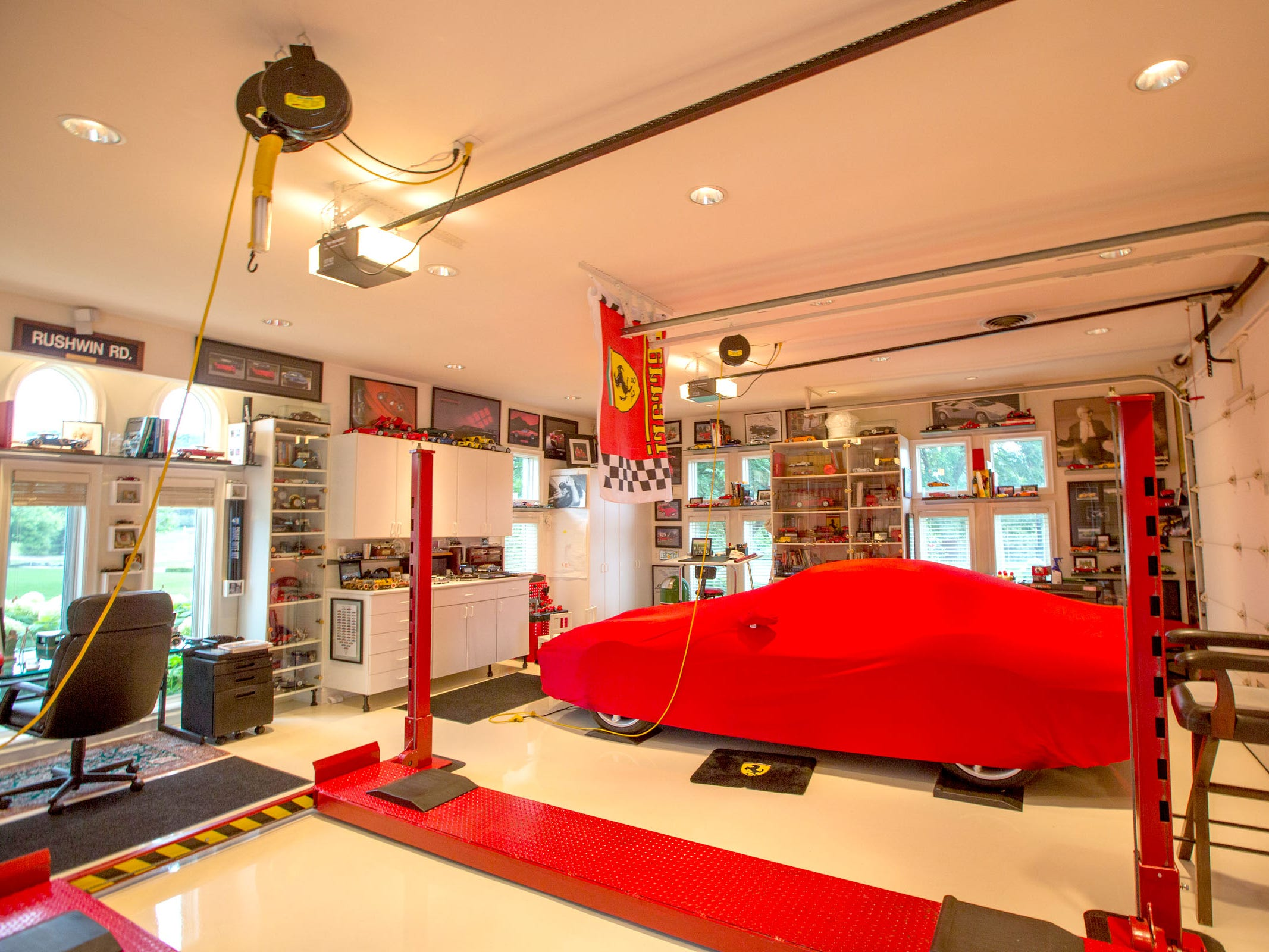 A Ferrari 550 Maranello is under the red cover in this car lover's garage.Two garages, under a porte cochere, with three bays each, also hold a 1995 Viper and a yellow 2005 Ford GT, both of which he helped bring to the market.