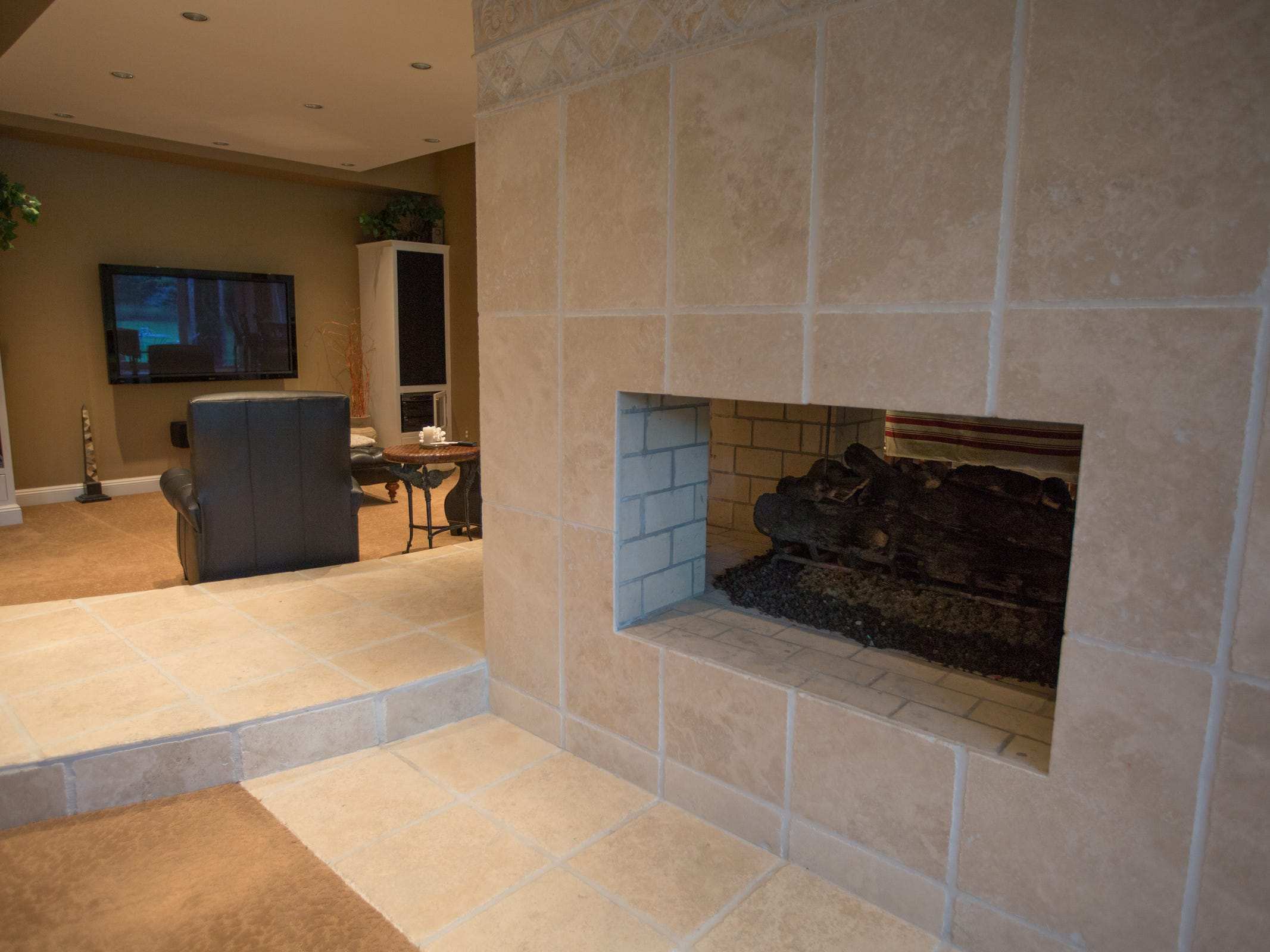 The third imposing fireplace is in the lower level party area. It has a large firebox, openings on four sides and powerful gas jets to fuel a bonfire. In all, there are five fireplaces.