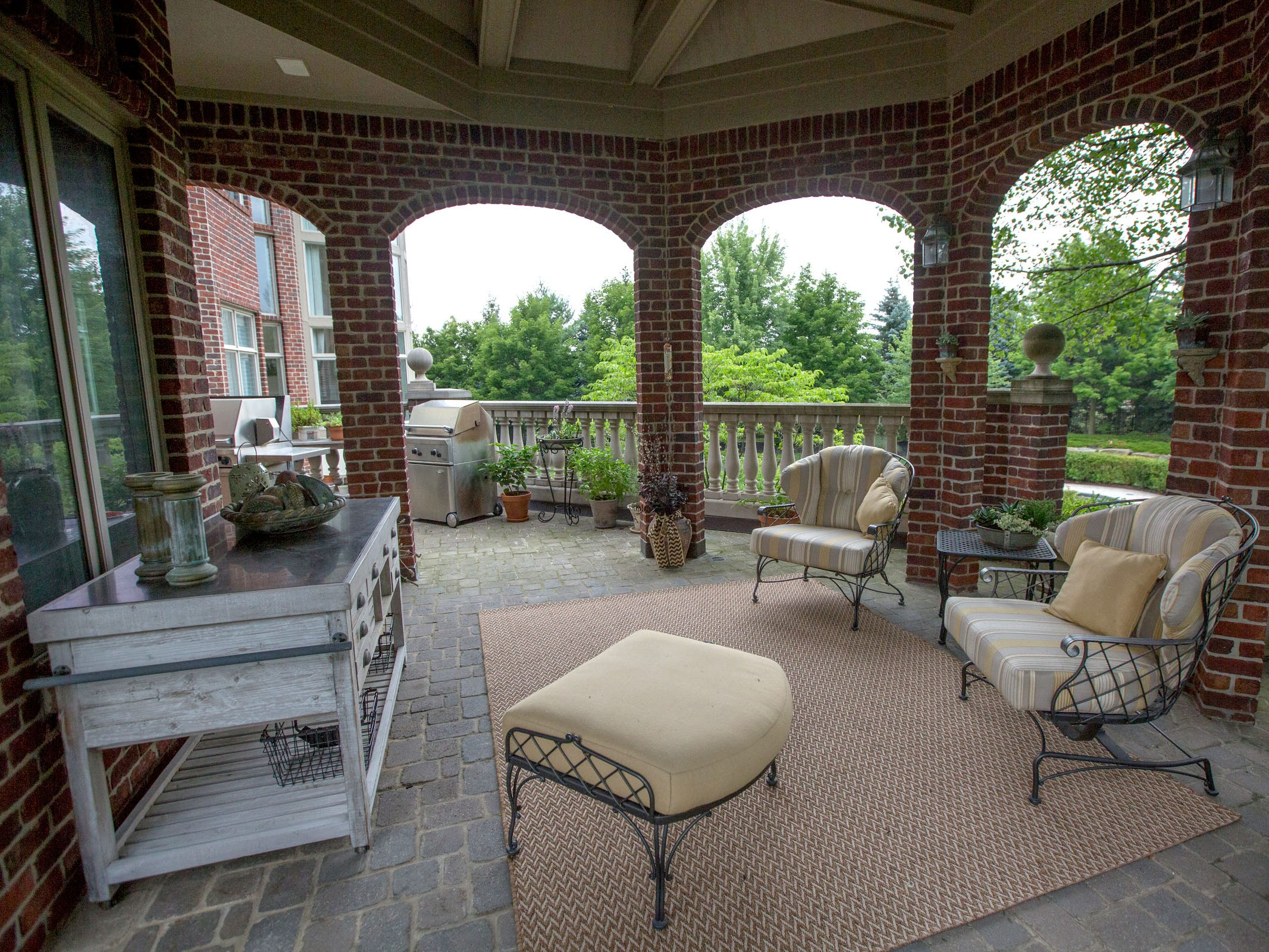 The outdoor grilling and seating area near the home's breakfast room.