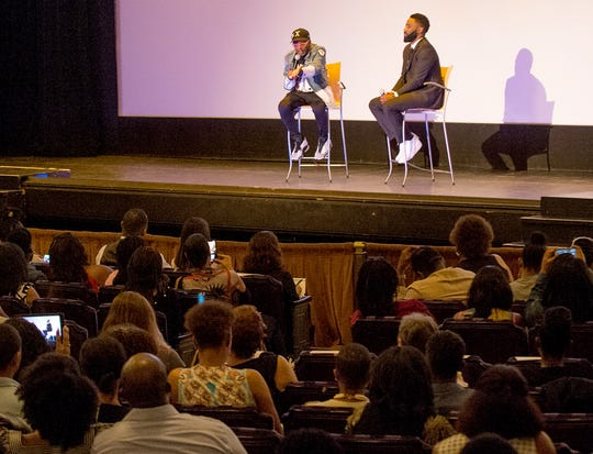 """Spike Lee, left, and John David Washington on stage after a screening of the movie """"BlacKkKlansman"""" at the Detroit Institute of Arts in Detroit on Aug. 4, 2018. Lee is the director and Washington plays Ron Stallworth, an African-American police officer from Colorado who successfully managed to infiltrate the local Ku Klux Klan."""