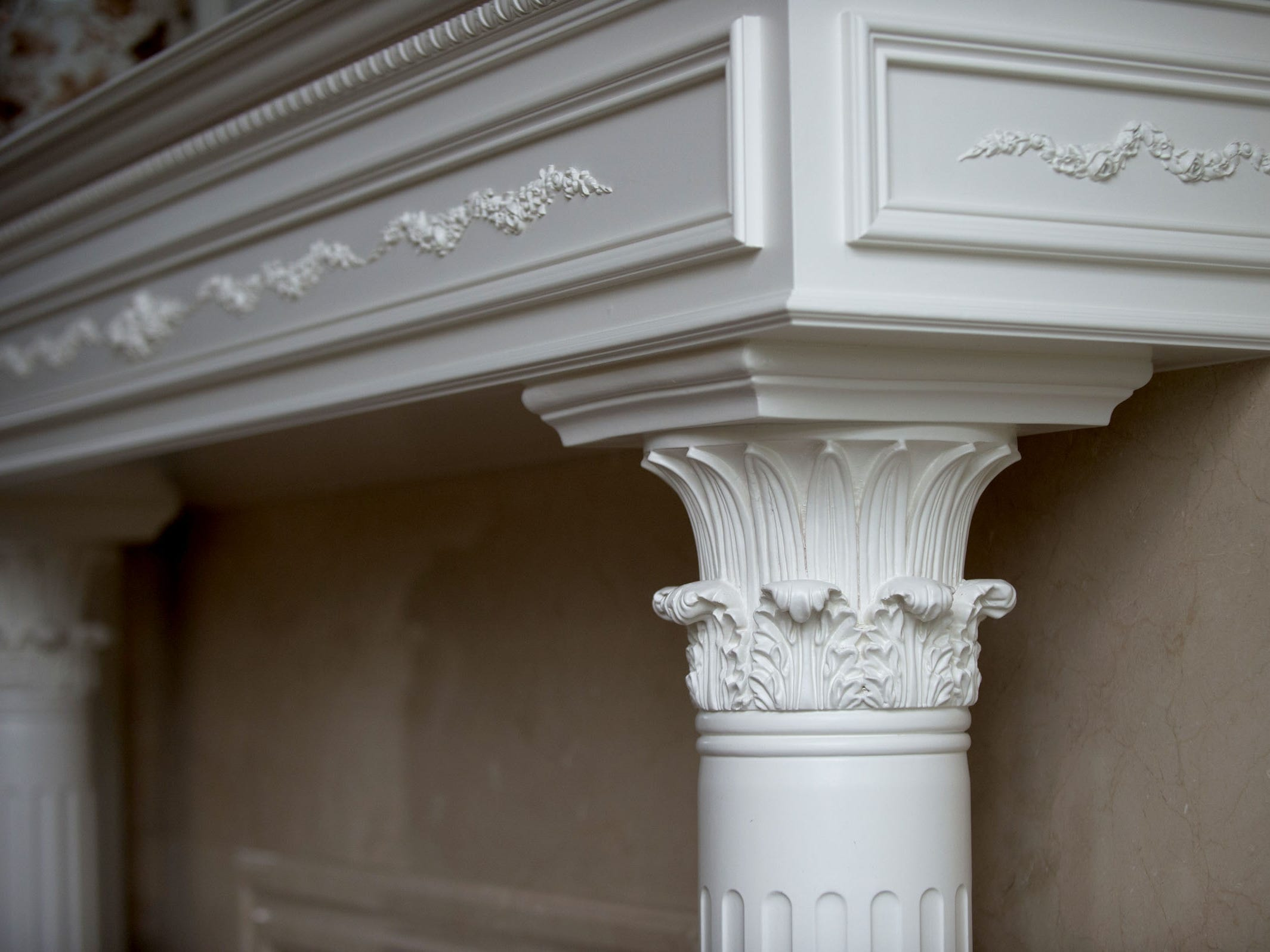 A detail from the living room's white marble fireplace.