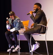 "Spike Lee, left, and John David Washington on stage after a screening of the movie ""BlacKkKlansman"" at the Detroit Institute of Arts in Detroit on Aug. 4, 2018. Lee is the director and Washington plays Ron Stallworth, an African-American police officer from Colorado who successfully managed to infiltrate the local Ku Klux Klan."