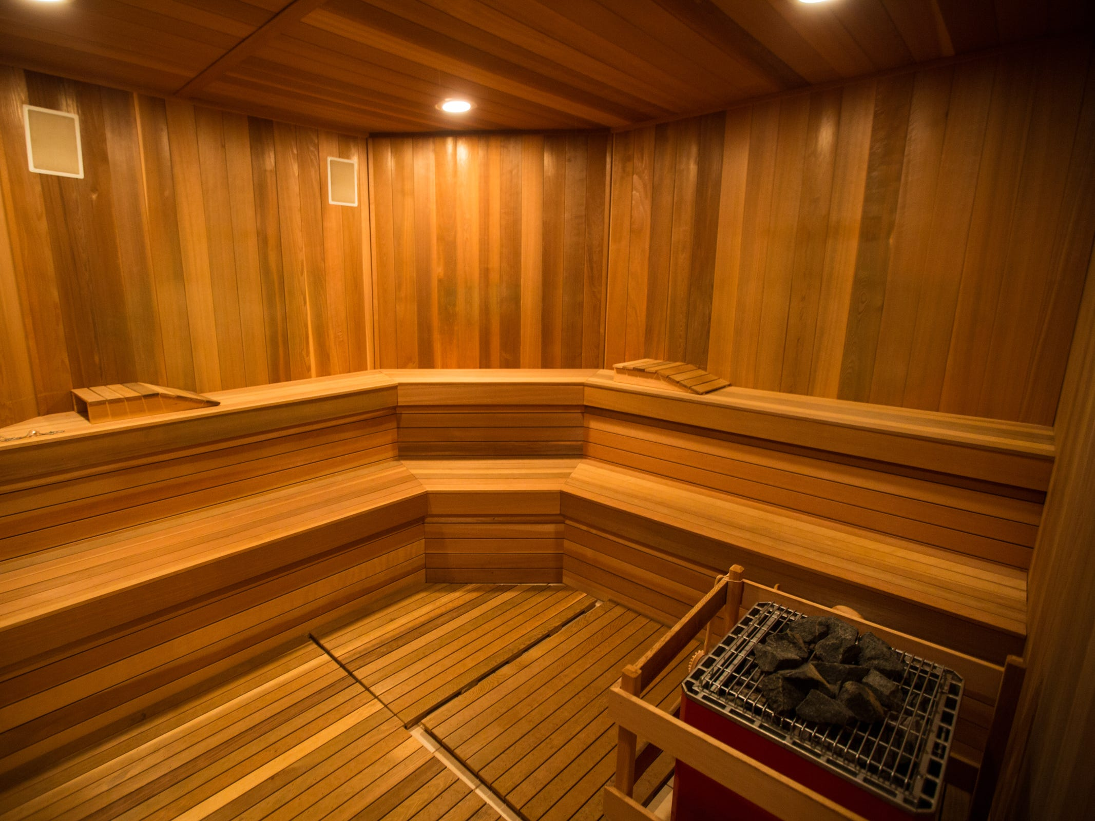 A cedar sauna in the home's lower level, adjacent the exercise space.