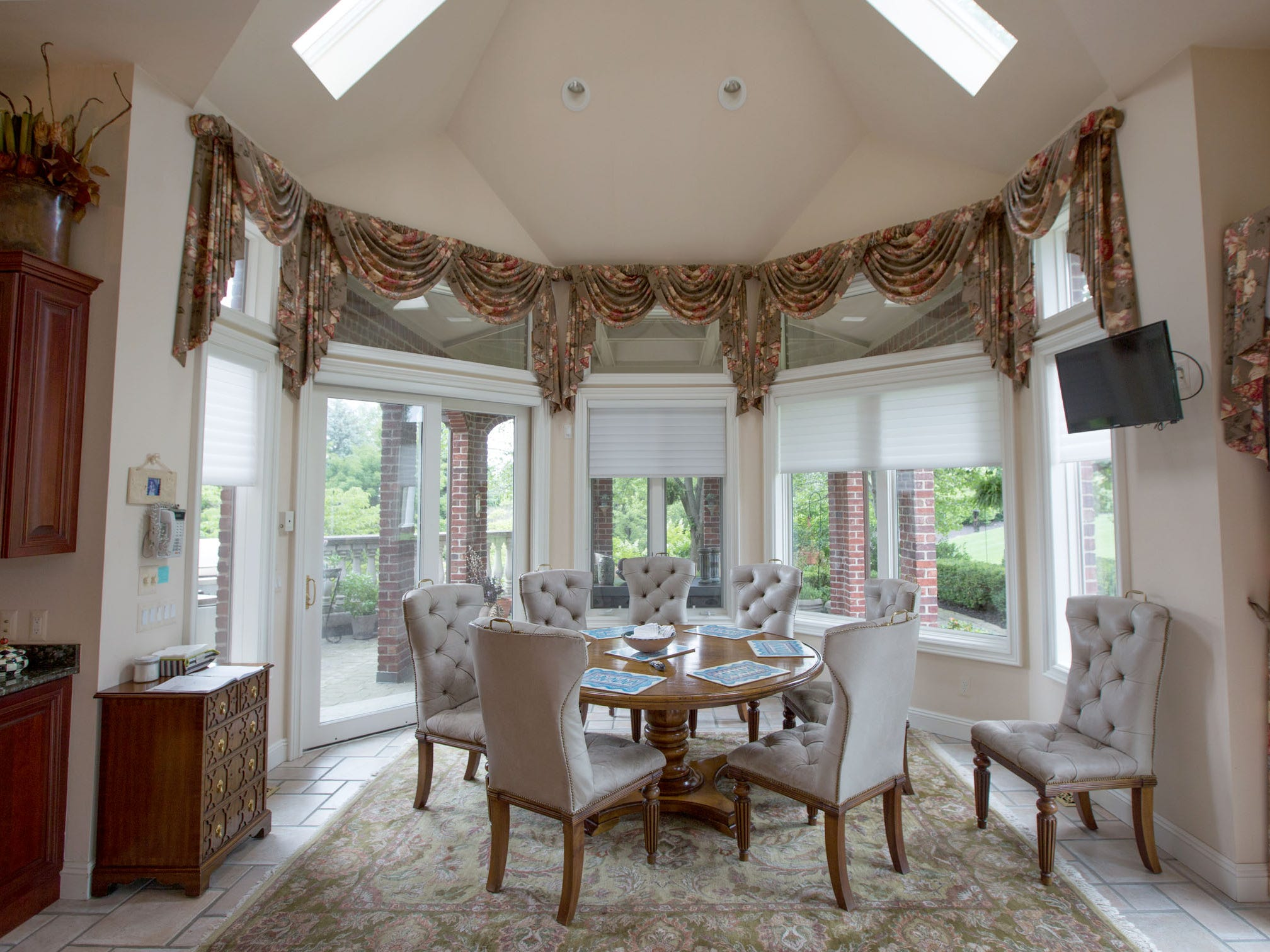 Off of the kitchen is a octagon breakfast room inside an octagon brick portico.