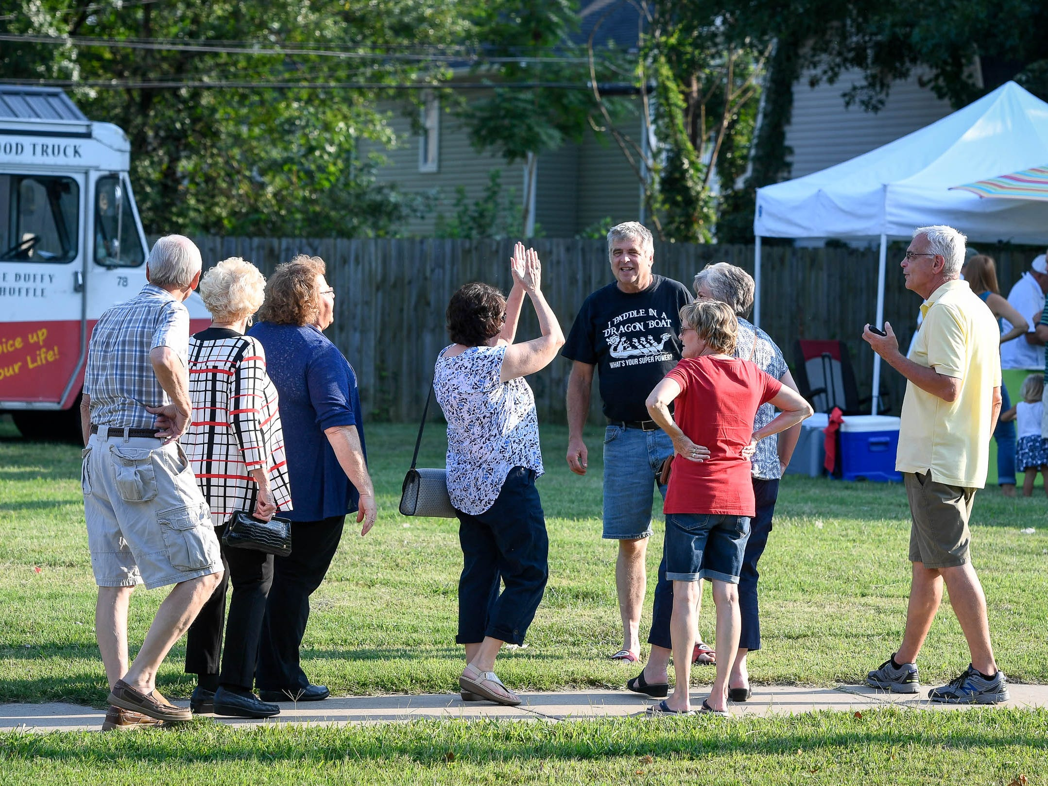 Hungry and excited people gather for the Haynie's Corner First Friday event in the downtown Arts District Friday, August 3, 2018.