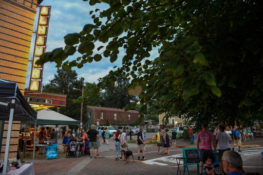 Evening falls during the Haynie's Corner First Friday event in the downtown Arts District Friday, August 3, 2018.