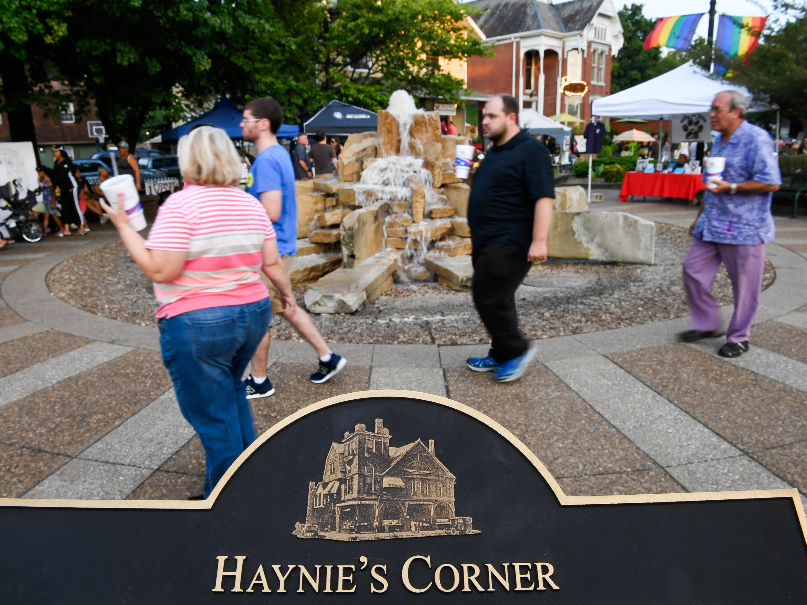 People strolling through Haynie's Corner for the First Friday event in the downtown Evansville Arts District Friday, August 3, 2018.