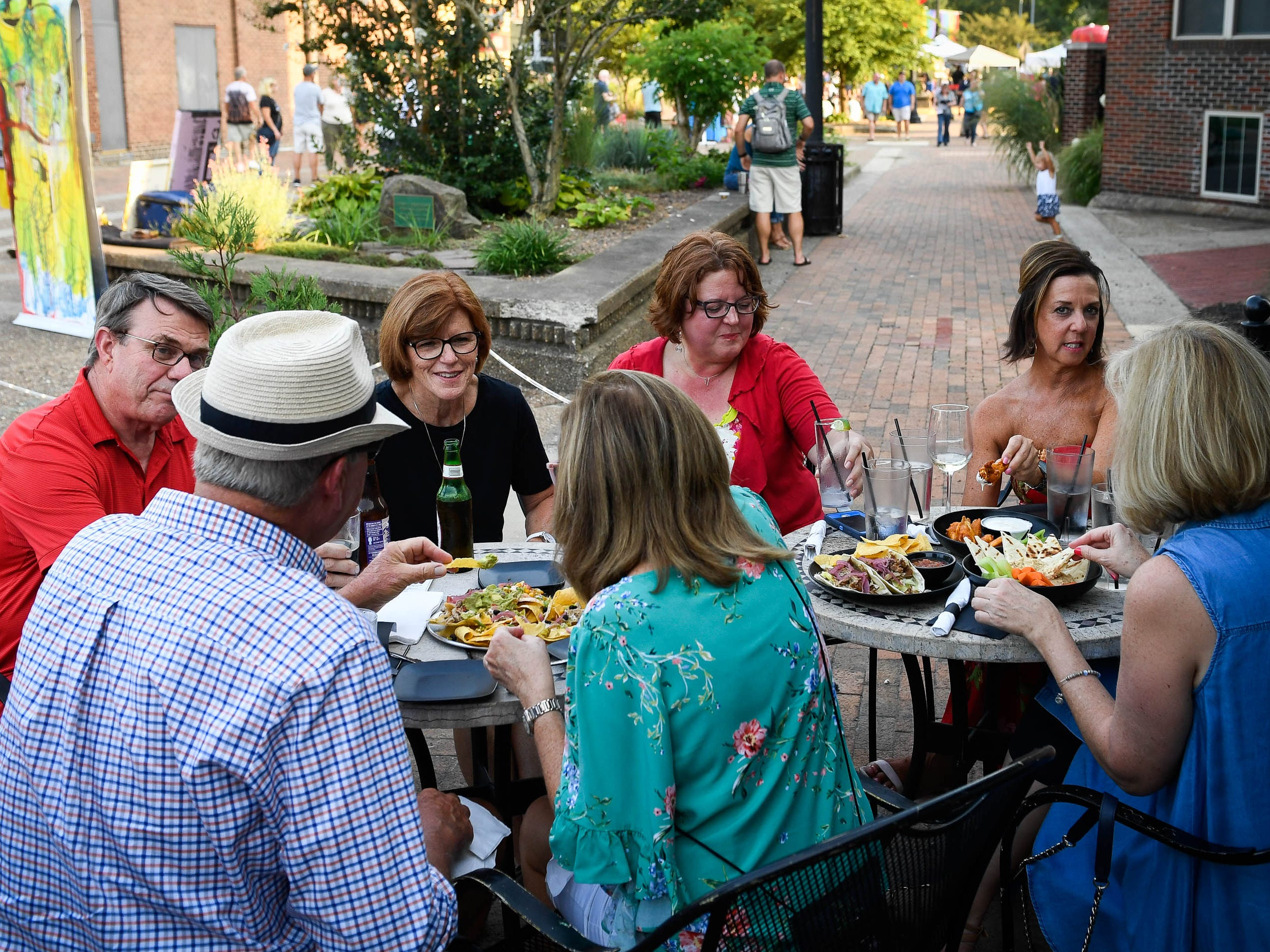 Outdoor dinning at the Bokeh Lounge during the Haynie's Corner First Friday event in the downtown Arts District Friday, August 3, 2018.