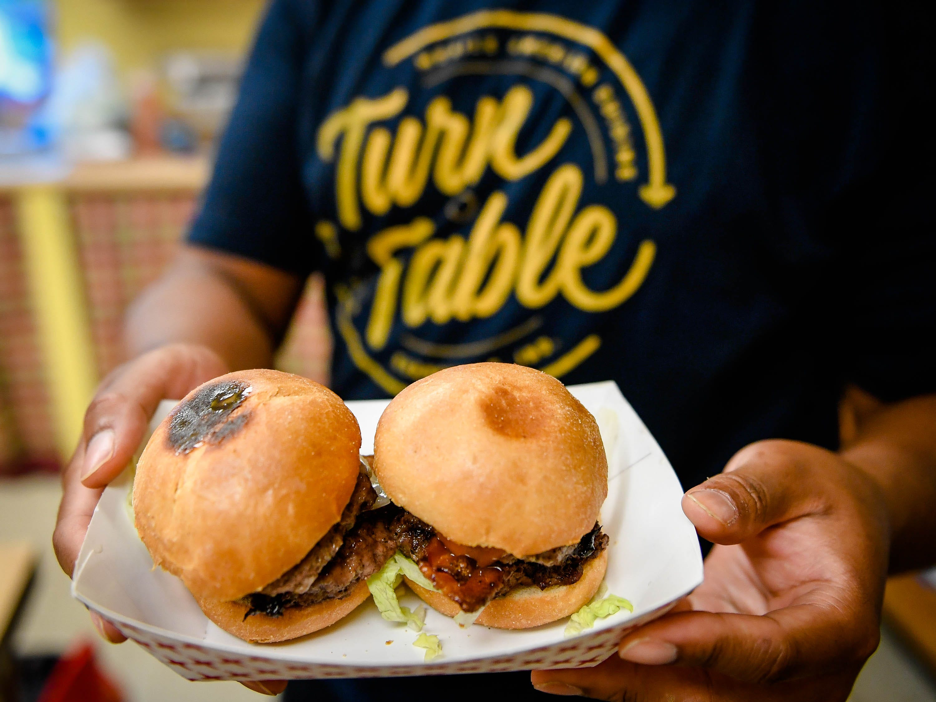 Double patty cheese sliders with Swiss and bacon served up by the Turn Table Mobile Cuisine at Patch Work Central during the Haynie's Corner First Friday event in the downtown Arts District Friday, August 3, 2018.