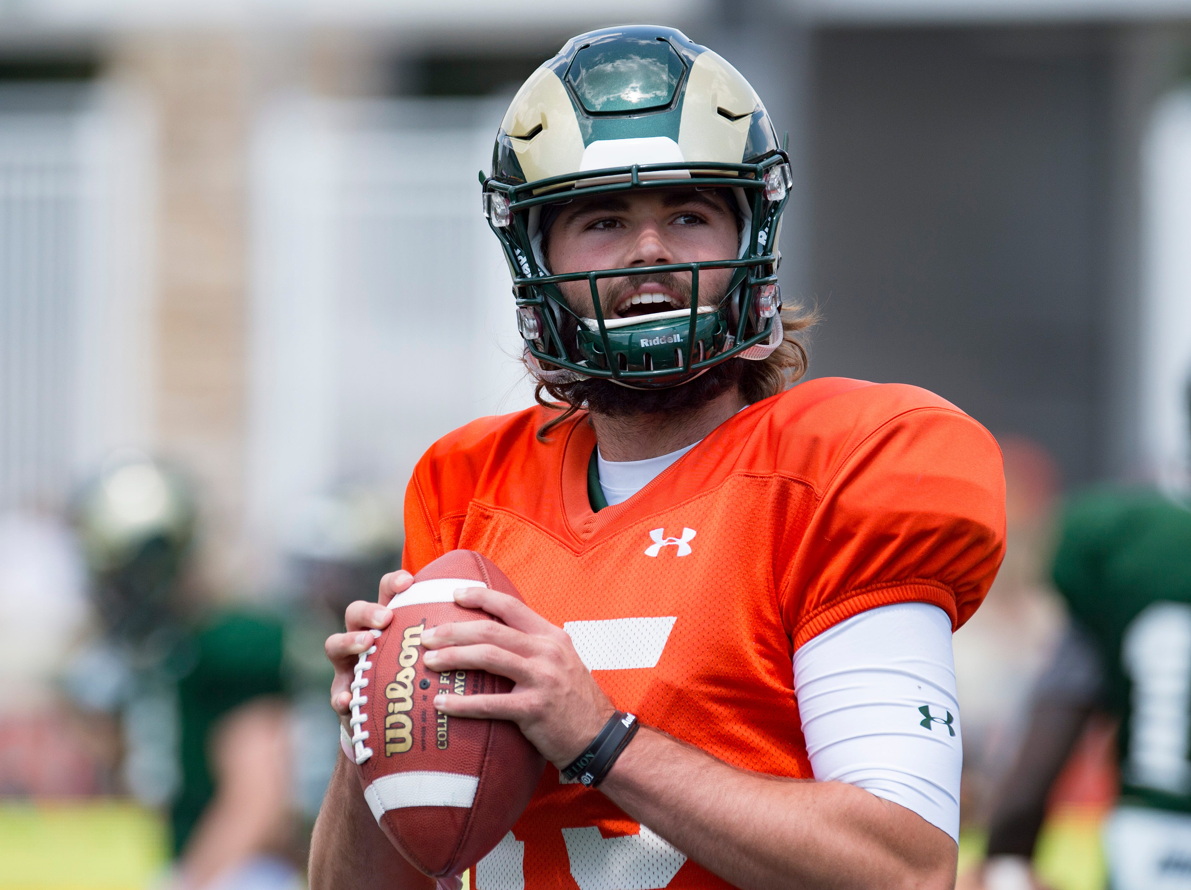CSU quarterback Collin Hill passes the ball as he warms up for a scrimmage during an open house hosted by the Rams outside of Canvas Stadium on Saturday, August 4, 2018.