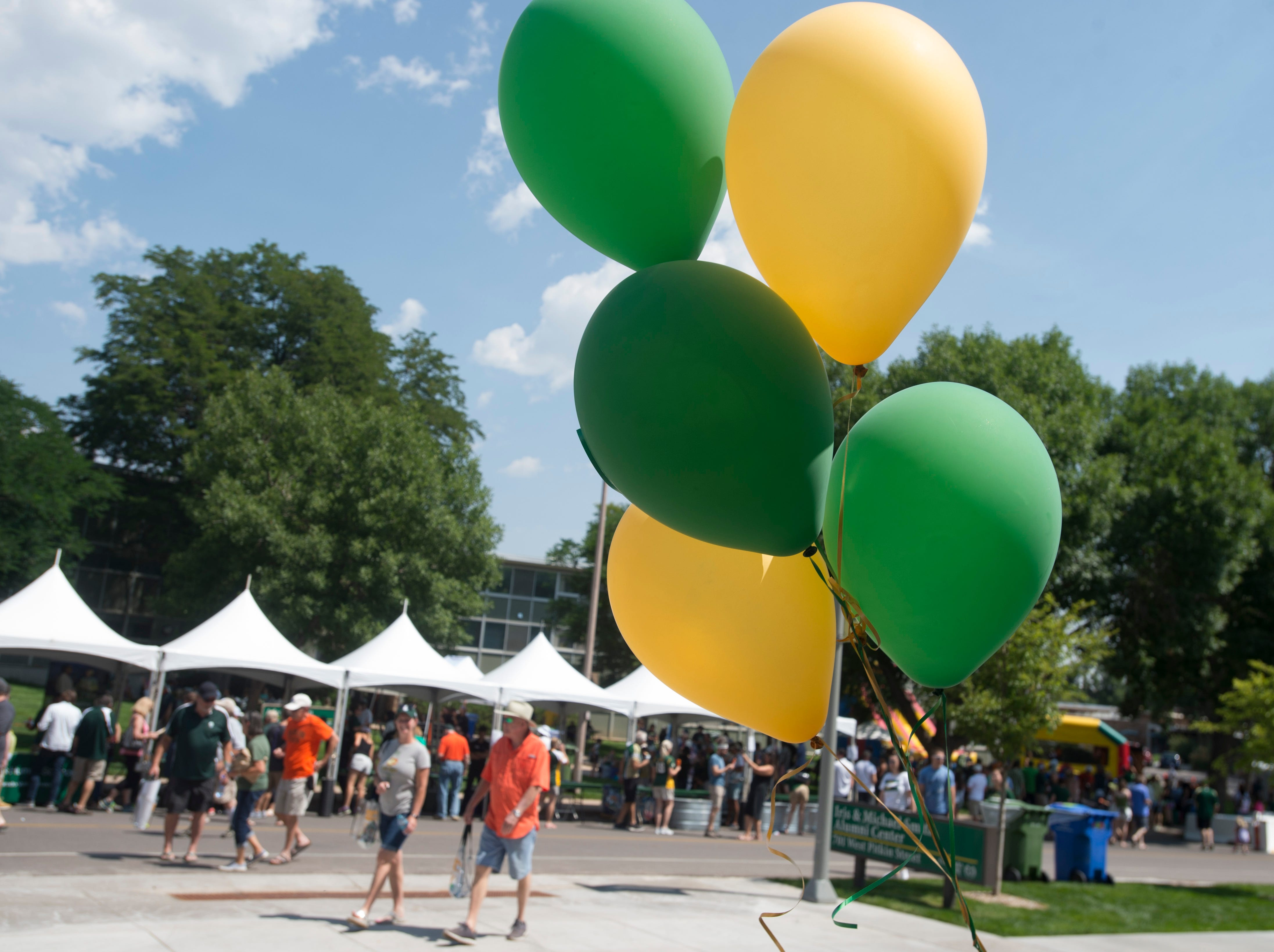 Green and gold balloons fly during an open house and scrimmage hosted by the Rams outside of Canvas Stadium on Saturday, August 4, 2018.