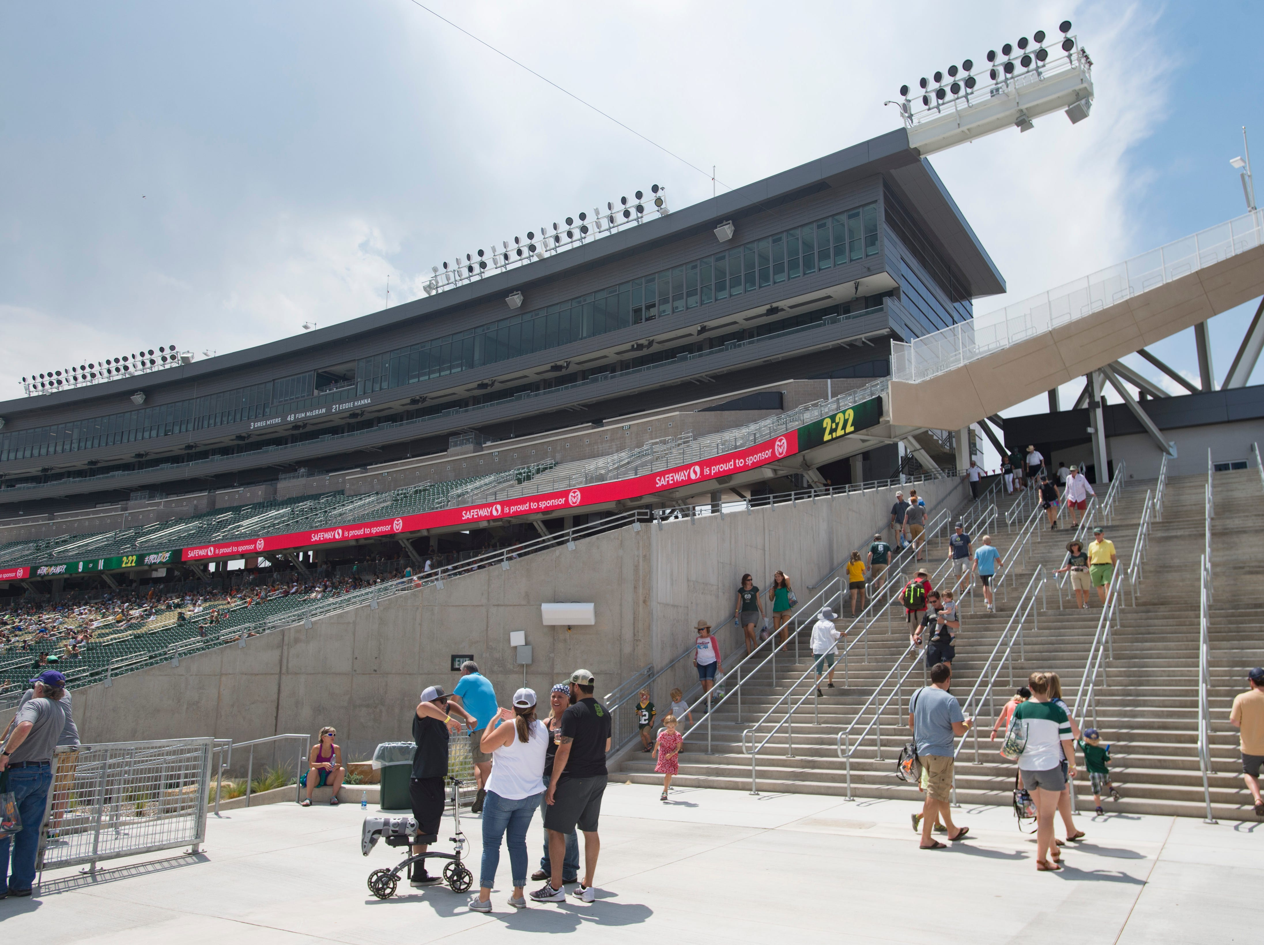 CSU fans wander Canvas Stadium during a scrimmage and open house hosted by the Rams on Saturday, August 4, 2018.