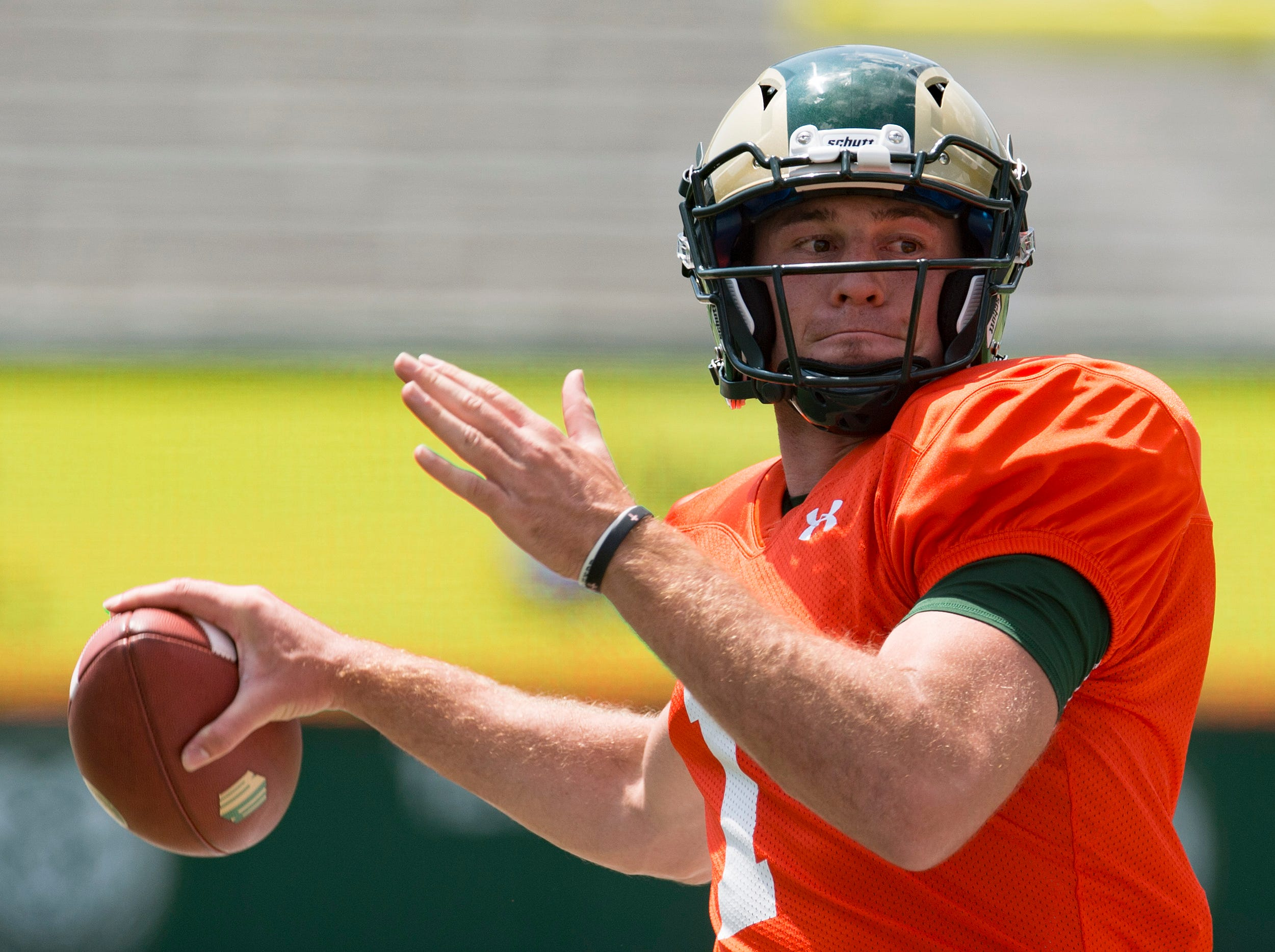 CSU quarterback K.J. Carta-Samuels passes the ball as he warms up for a scrimmage during an open house hosted by the Rams outside of Canvas Stadium on Saturday, August 4, 2018. Carta-Samuels is a redshirt senior graduate transfer from the University of Washington.