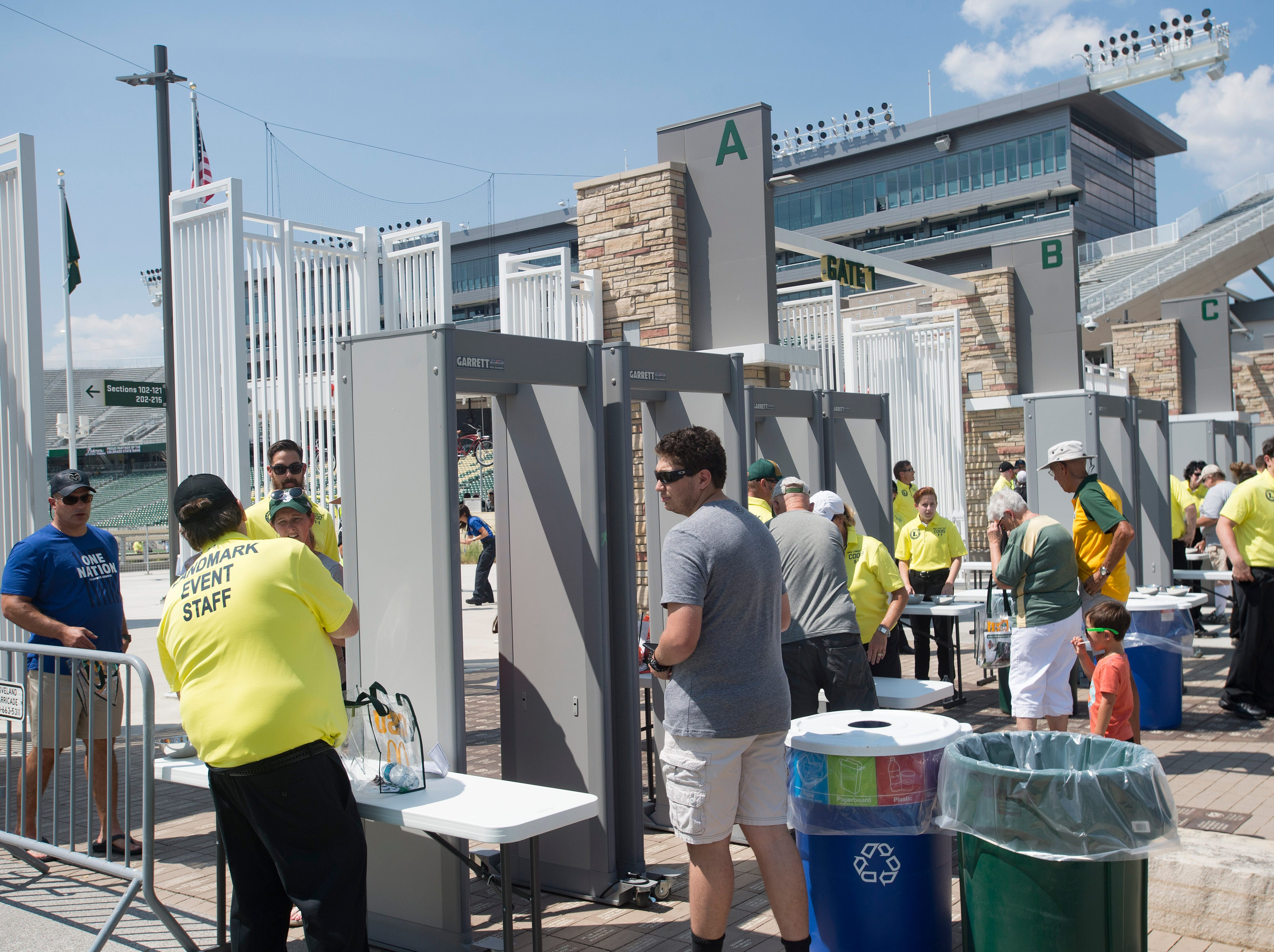 CSU fans enter through metal detectors along the north gates of Canvas Stadium during an open house and scrimmage hosted by the Rams on Saturday, August 4, 2018. The security measures are new this season.