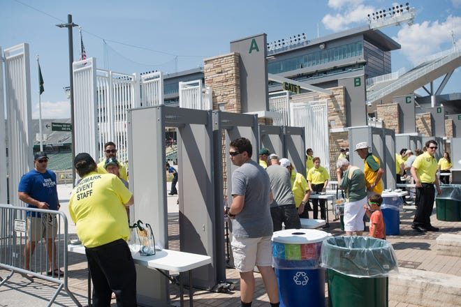 CSU fans pass through metal detectors at the north gate to Canvas Stadium during an open house and scrimmage Aug. 4. Many fans blamed the metal detectors, new this year, for long delays getting into the stadium for last Saturday's season opener.