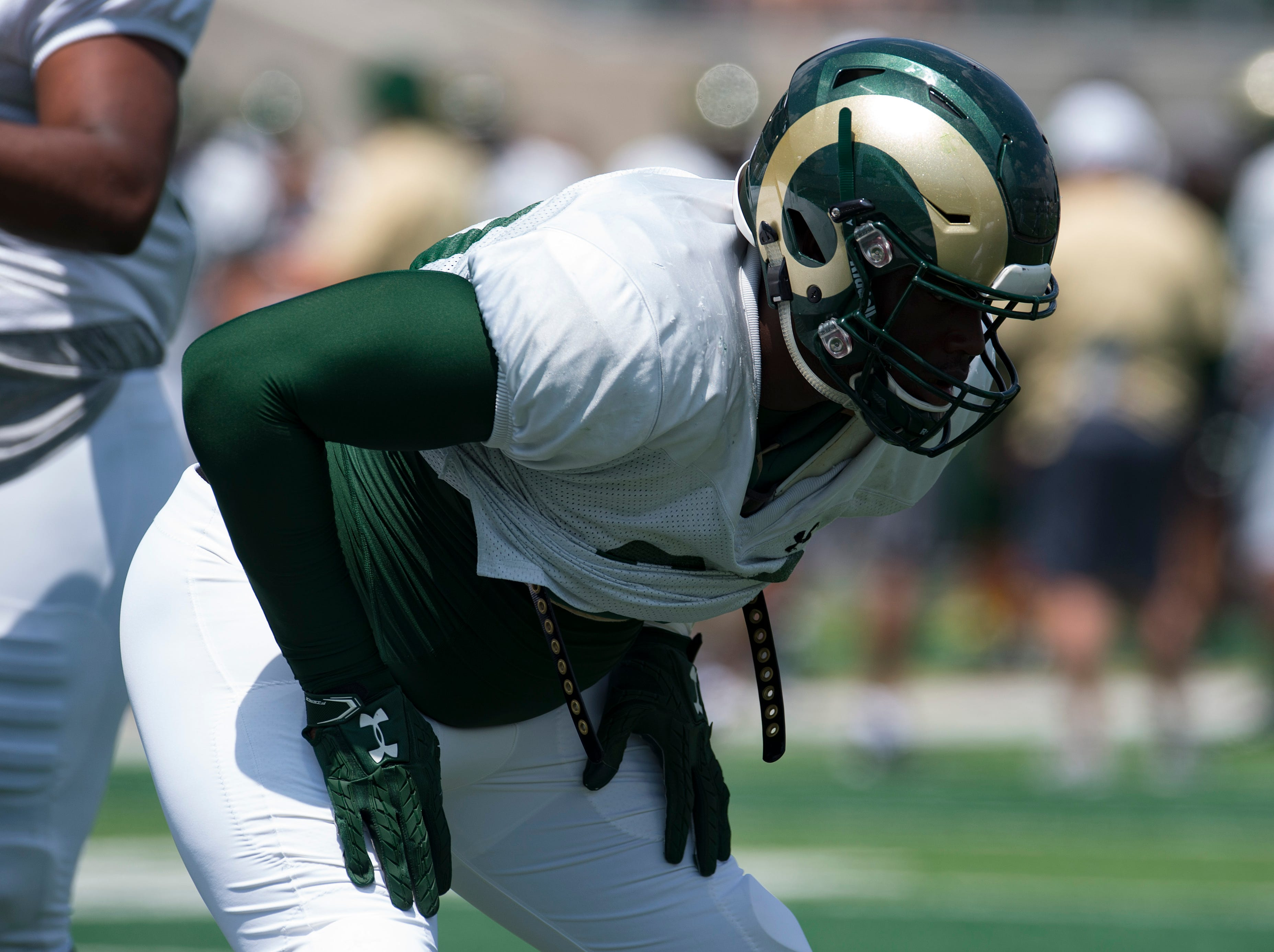 CSU defensive end Damion Dickens warms up for a scrimmage during an open house hosted by the Rams outside of Canvas Stadium on Saturday, August 4, 2018. Dickens is a junior transfer from Copiah-Lincoln Community College.