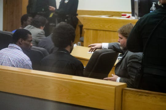 Defense attorney K.J. Myllynen speaks with his client Diante Davis (right) and his co-defendant Eric Fletcher (left).