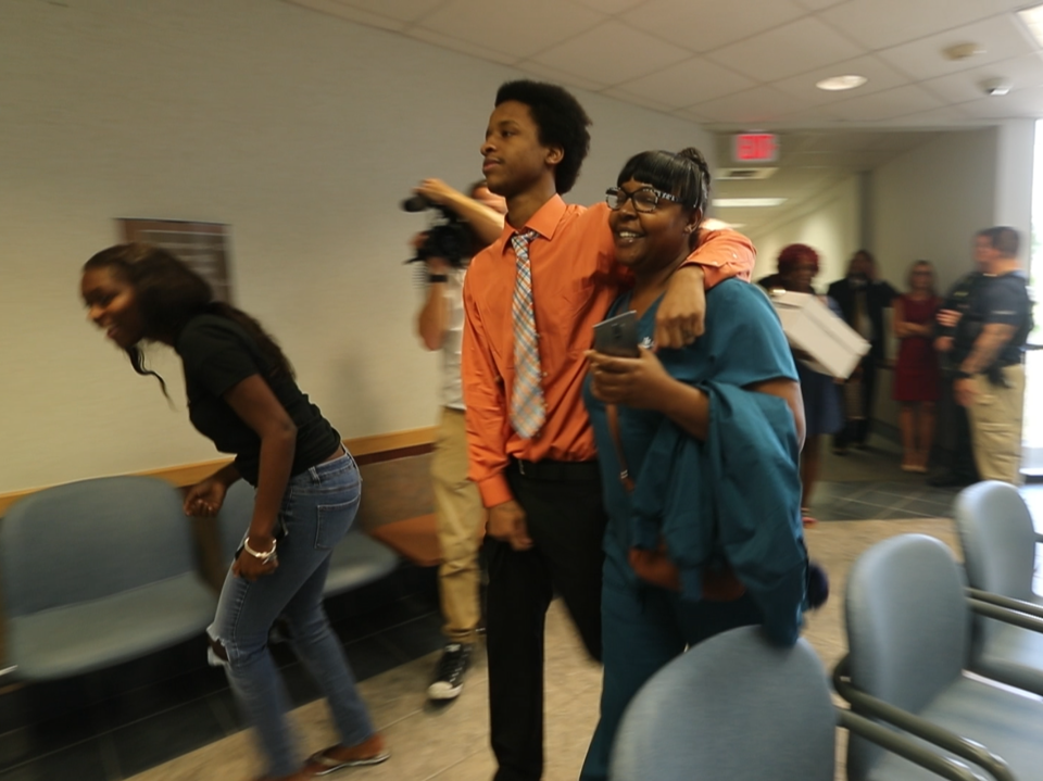 Diante Davis and family and friends as they leave the courthouse Saturday after Davis was found not guilty of being a member of a gang by a Lee County jury.