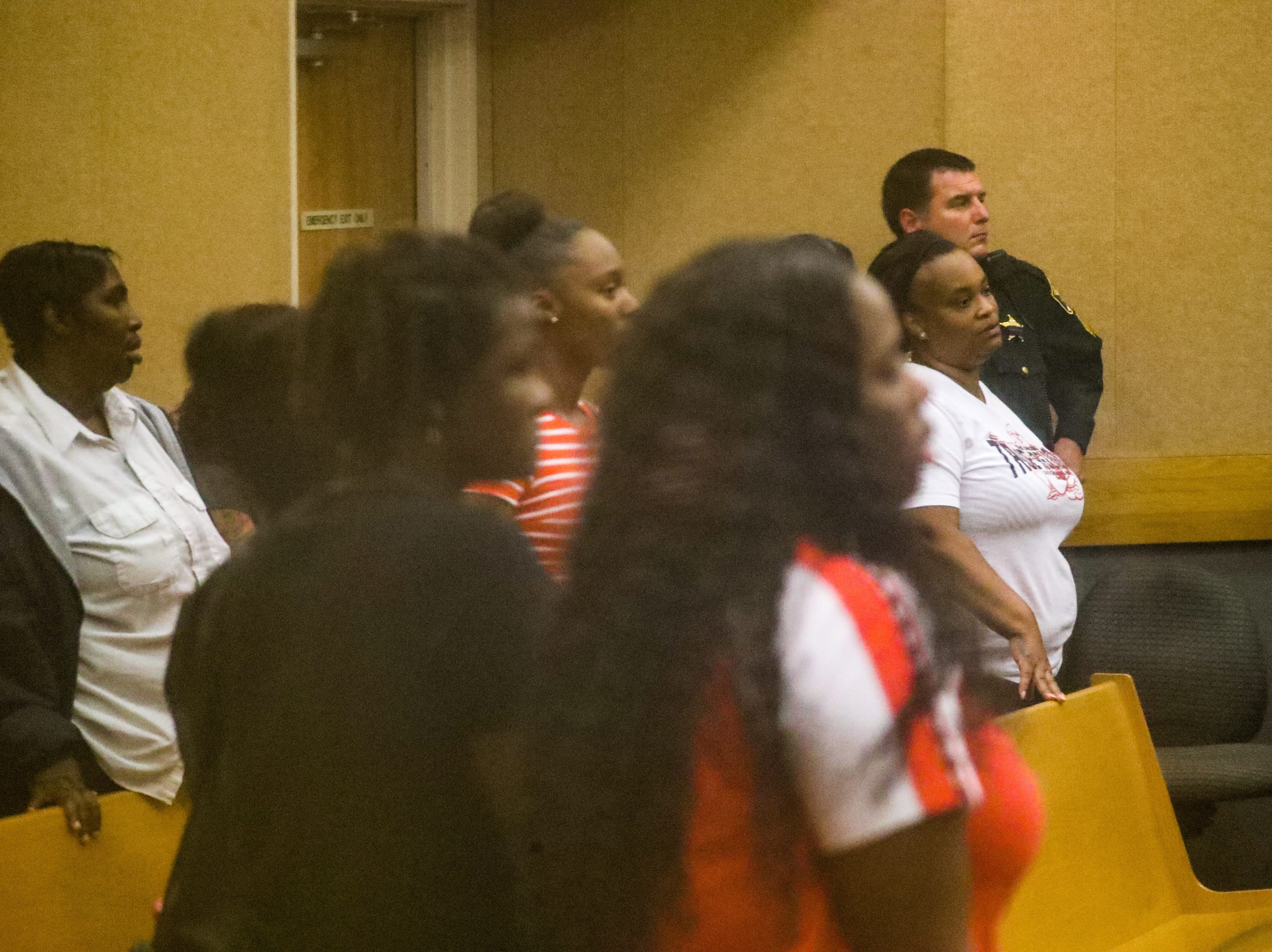 Family and friends of four men accused of being gang members watch trial proceedings at a Lee County courtroom late Friday night.