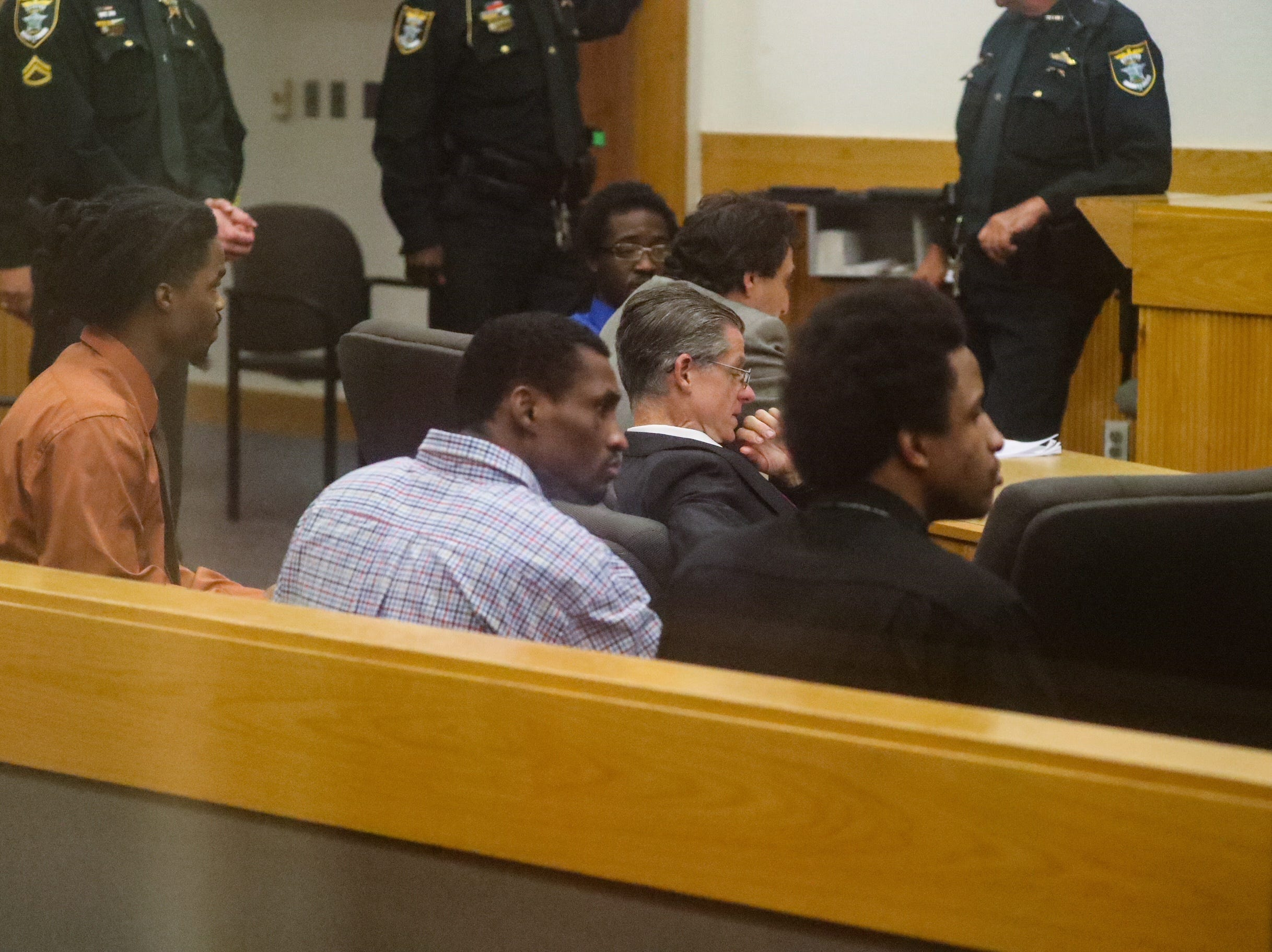 The four men accused of being gang  members in Fort Myers sit and wait to hear from the jury.