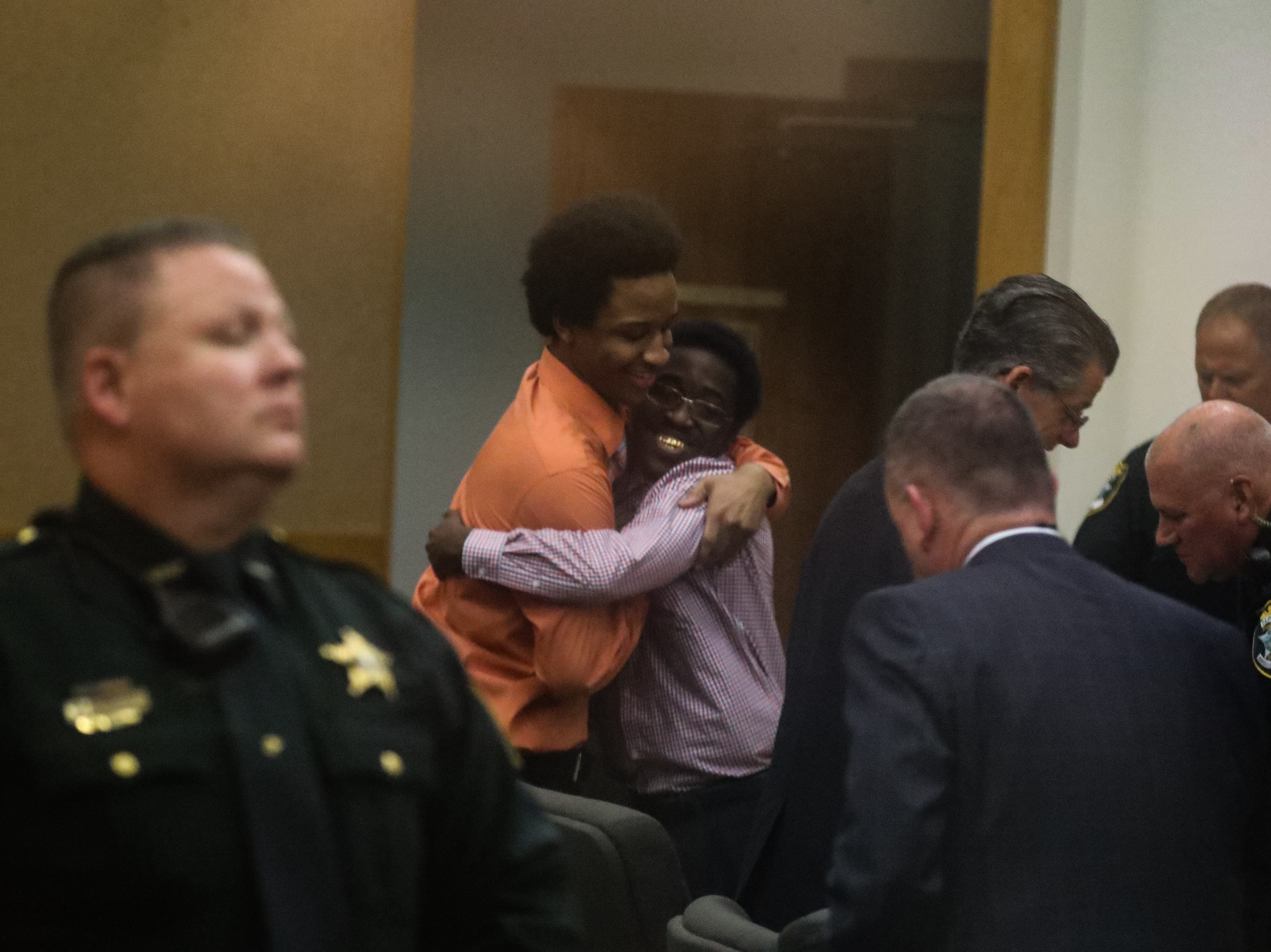 Diante Davis and James Brown hug each other after being found not guilty of being members of a gang Saturday by a Lee County jury.