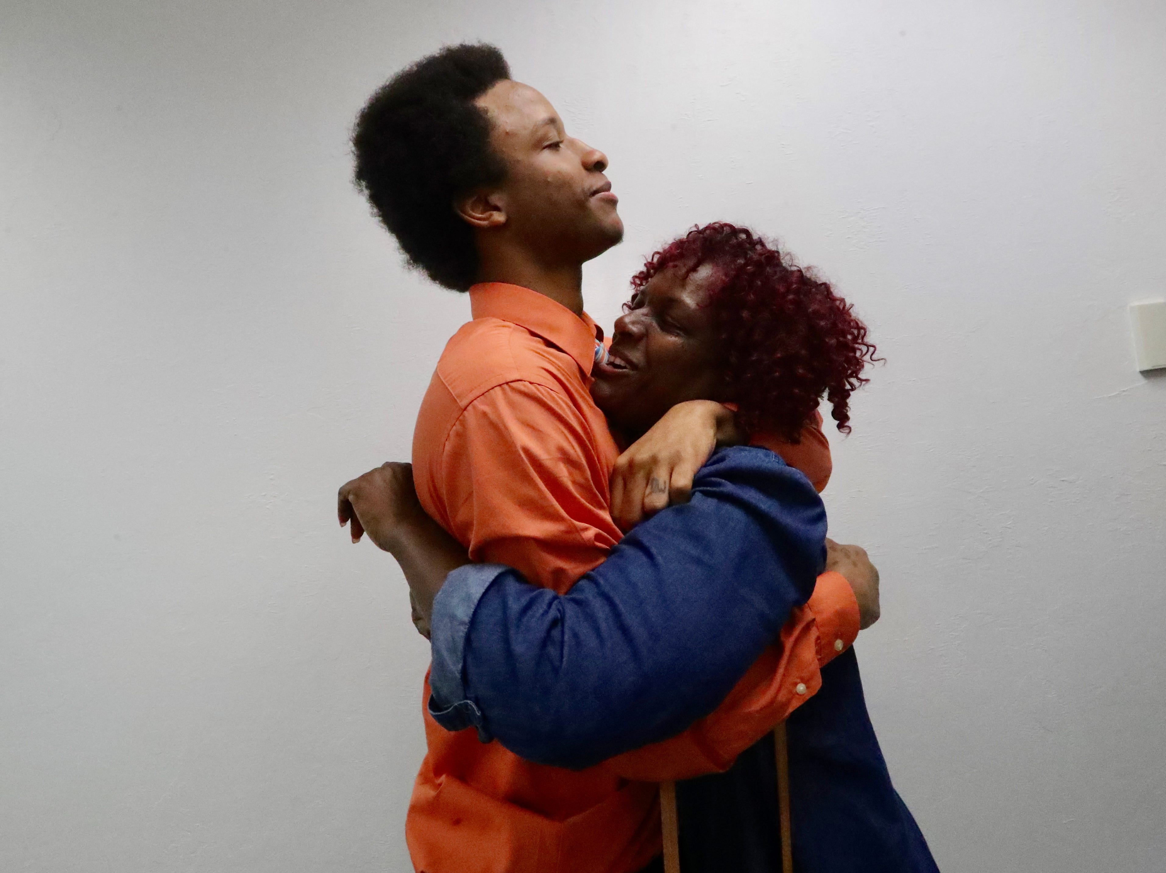 Paula Burger, mother of Diante Davis, hugs her son after he and three others were found not guilty of being members of a gang Saturday by a Lee County jury.