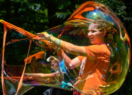 Lydia Jones makes a giant soap bubble during the Party in the Park Back to School event held at John James Audubon State Park last year.