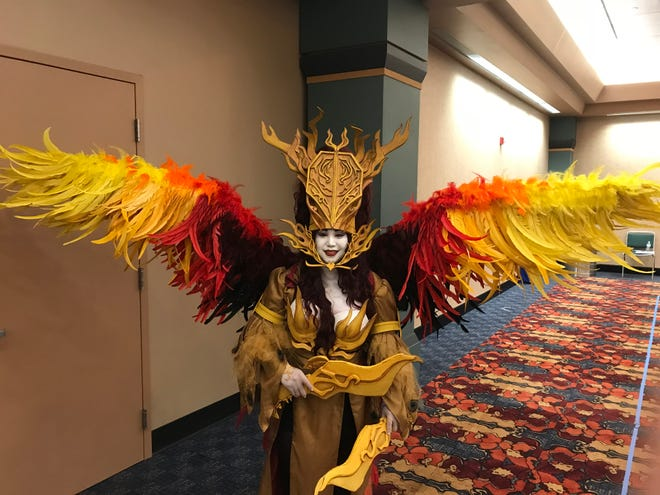 Monica Paprocki fell in love with the Phoenix monster from the Rising Sun board game. So she created this costume with more than 800 feathers and wings that are remote-controlled.