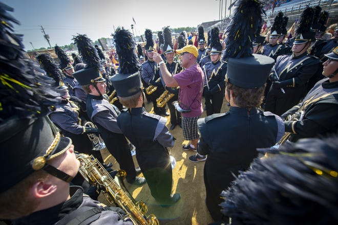 Band director for Noblesville High School's marching band, Eric Thornbury,  gets the performers fired up before their competition. Over 40 marching bands competed in the annual Band Day competition at the Indiana State Fair, Saturday, Aug. 4, 2018.
