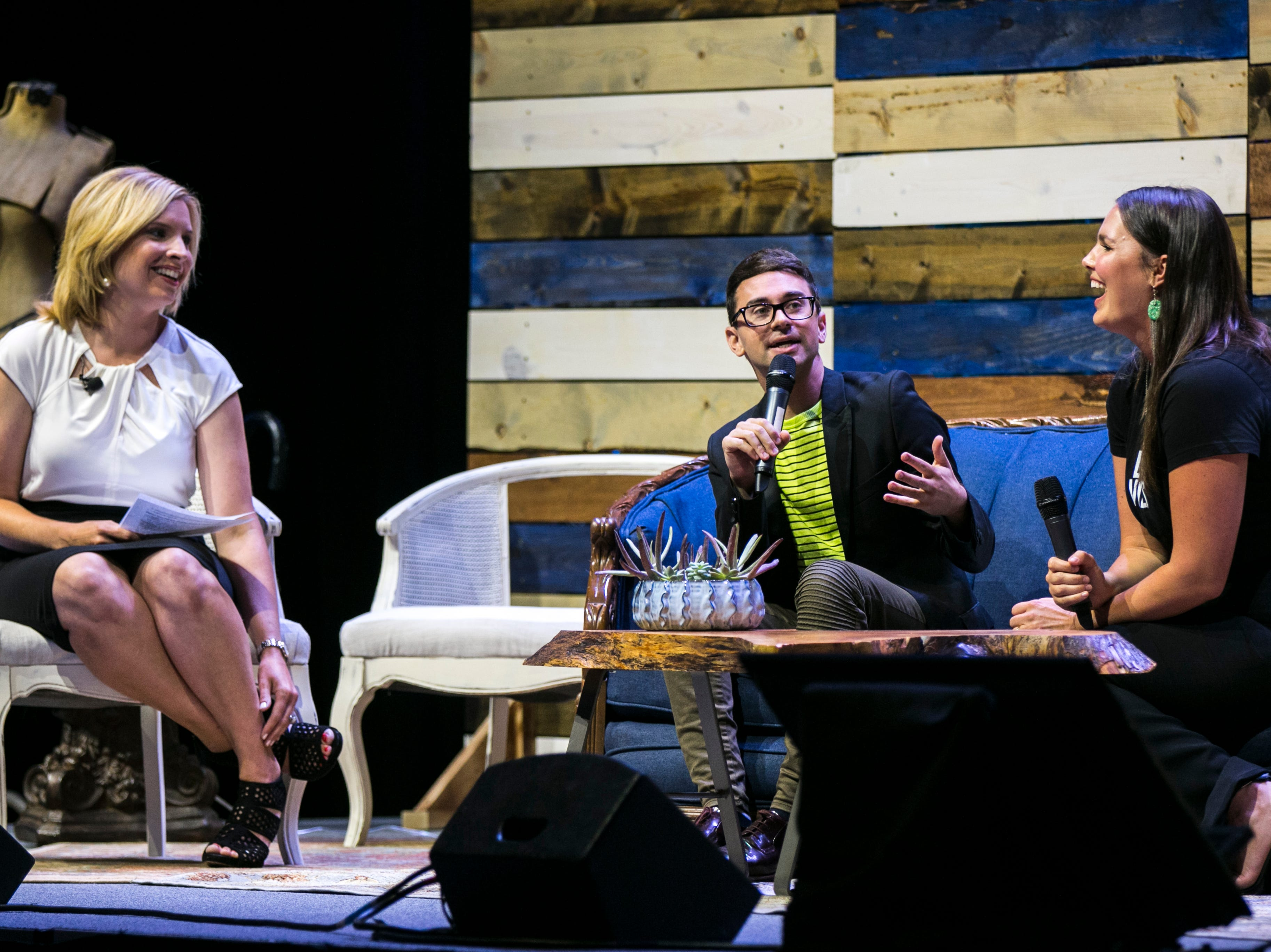 "Christian Siriano (center) jokes with Candice Huffine (right) during ""Newbo Evolve"" on Friday, Aug. 3, 2018, at the Cedar Rapids Convention Complex in Cedar Rapids, Iowa."