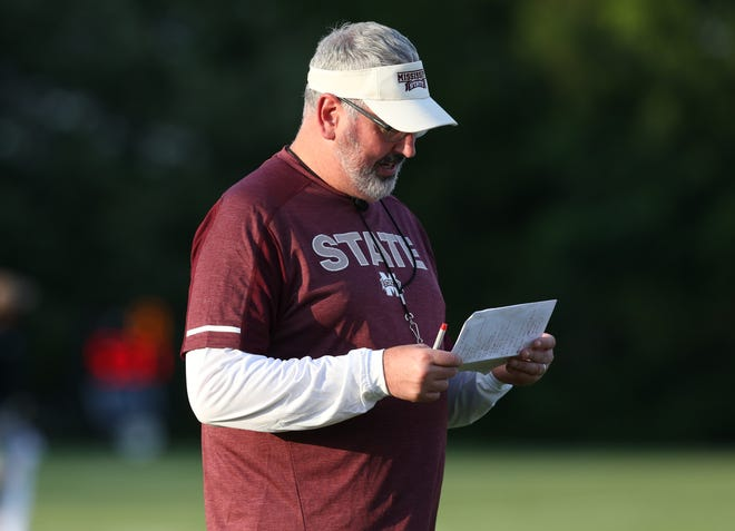 Head coach Joe Moorhead looks at his notes during Mississippi State's first practice of training camp on Aug. 3, 2018.