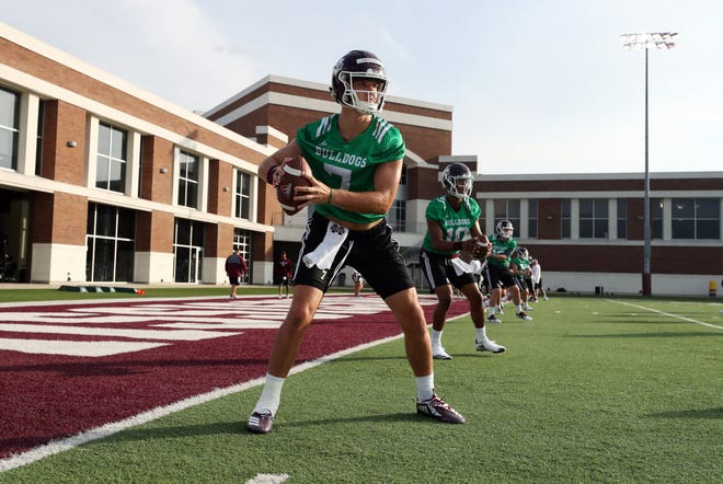 Senior quarterback Nick Fitzgerald leads the QB's through drills during the first practice of training camp on Aug. 3, 2018.