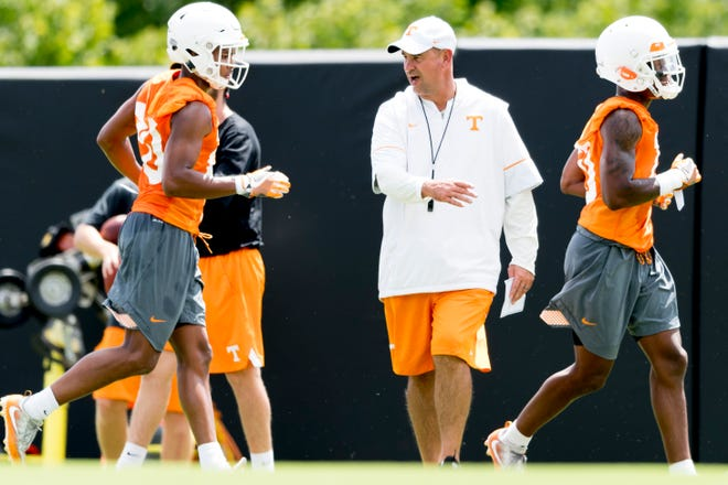 Tennessee Head Coach Jeremy Pruitt coaches during Tennessee Vols football practice at Haslam Field in Knoxville, Tennessee on Saturday, August 4, 2018.