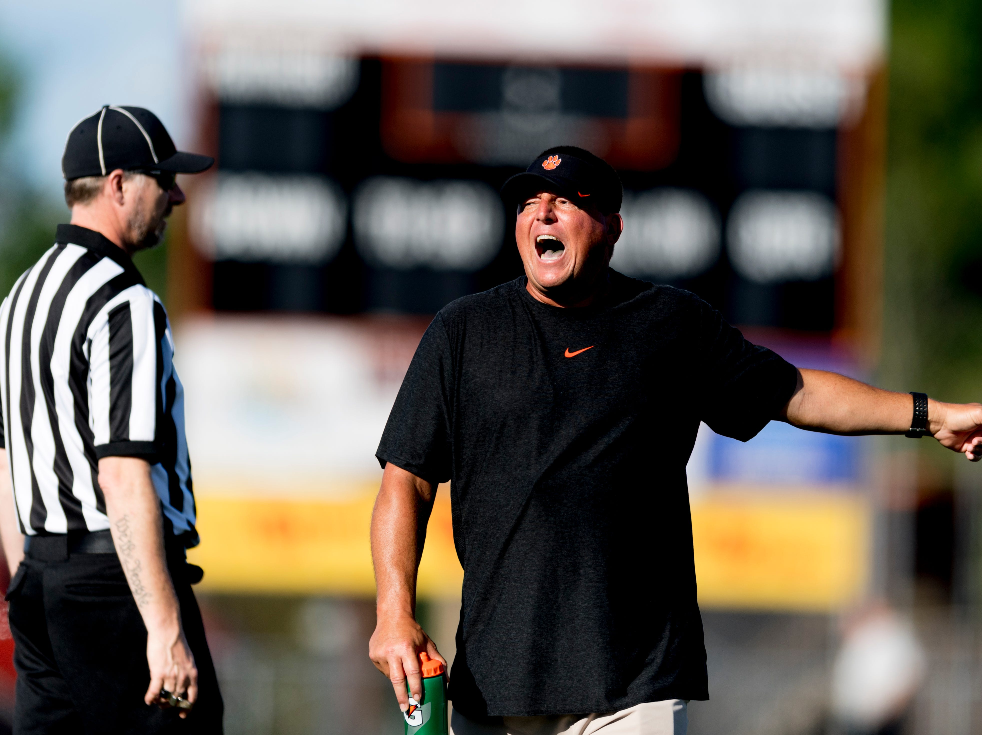 Powell Head Coach Matt Lowe calls during a scrimmage game between Powell and Carter at Powell High School in Powell, Tennessee on Friday, August 3, 2018.