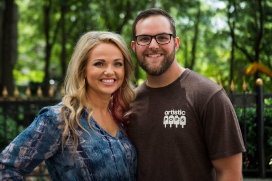 Kristina Killebrew and her husband, Jon, co-owners of Artistic Pops, pose for a photo next to their stand at the farmers market in downtown Knoxville on Saturday, Aug. 4, 2018. Artistic Pops are gluten-free, nut-free and dairy-free popsicles.