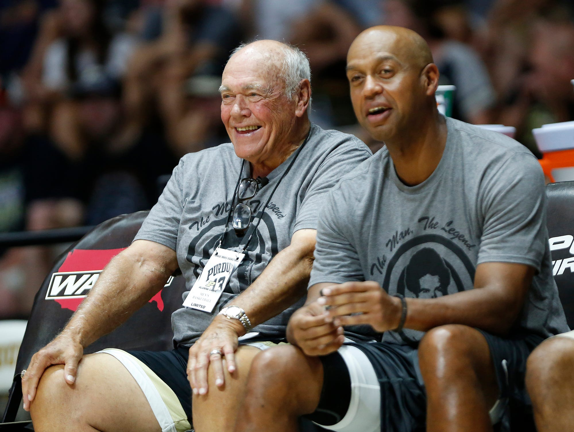 Black team coach Gene Keady laughs with Troy Lewis as they face the Gold team in the Purdue Alumni basketball game Saturday, August 4, 2018, at Mackey Arena. The Black team defeated the Gold 101-91.