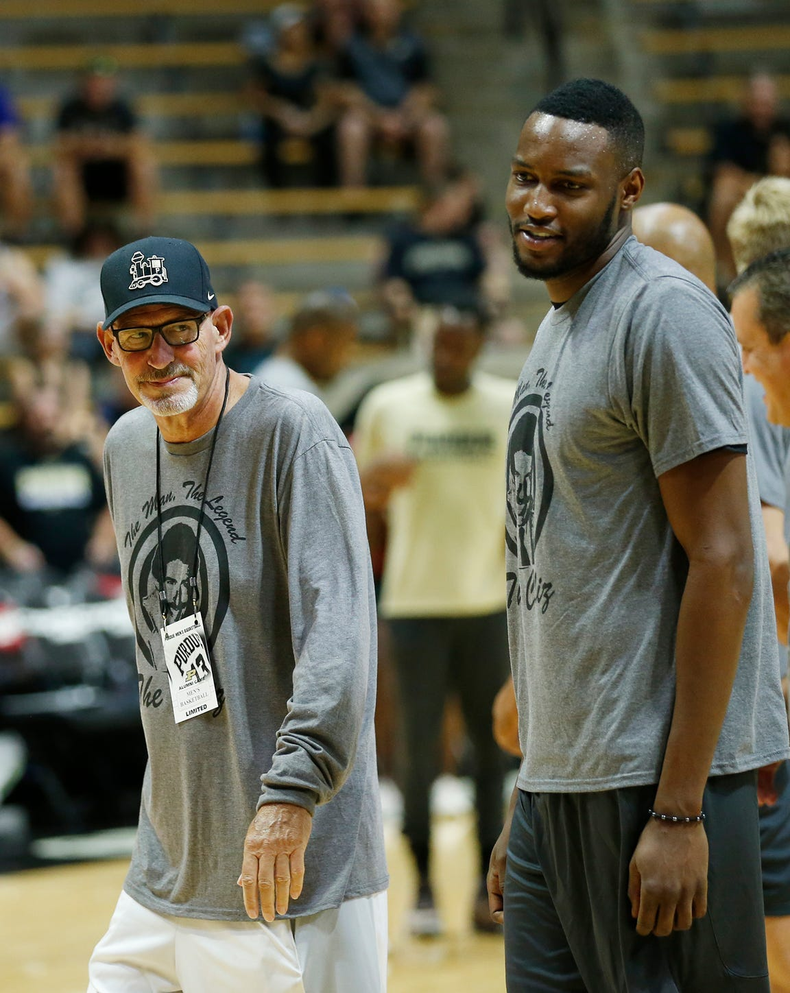 Larry Clisby walks onto Keady Court to talk with the players before the start of the Purdue Alumni basketball game Saturday, August 4, 2018, at Mackey Arena. The long-time radio voice of Boilermakers basketball is battling cancer. The Black team defeated the Gold 101-91.