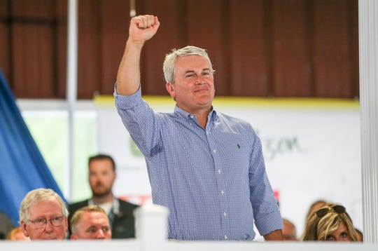 Representative 1st District James Comer pumps his fist in the air while being introduced Saturday afternoon at the Fancy Farm picnic in Fancy Farm, Ky.