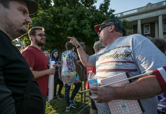 NRA supporter Jeff Reeves tries to make a point with anti-NRA supporter man who only gave his name as Monty before the National Rifle Association President Oliver North spoke at Murray State Friday evening.