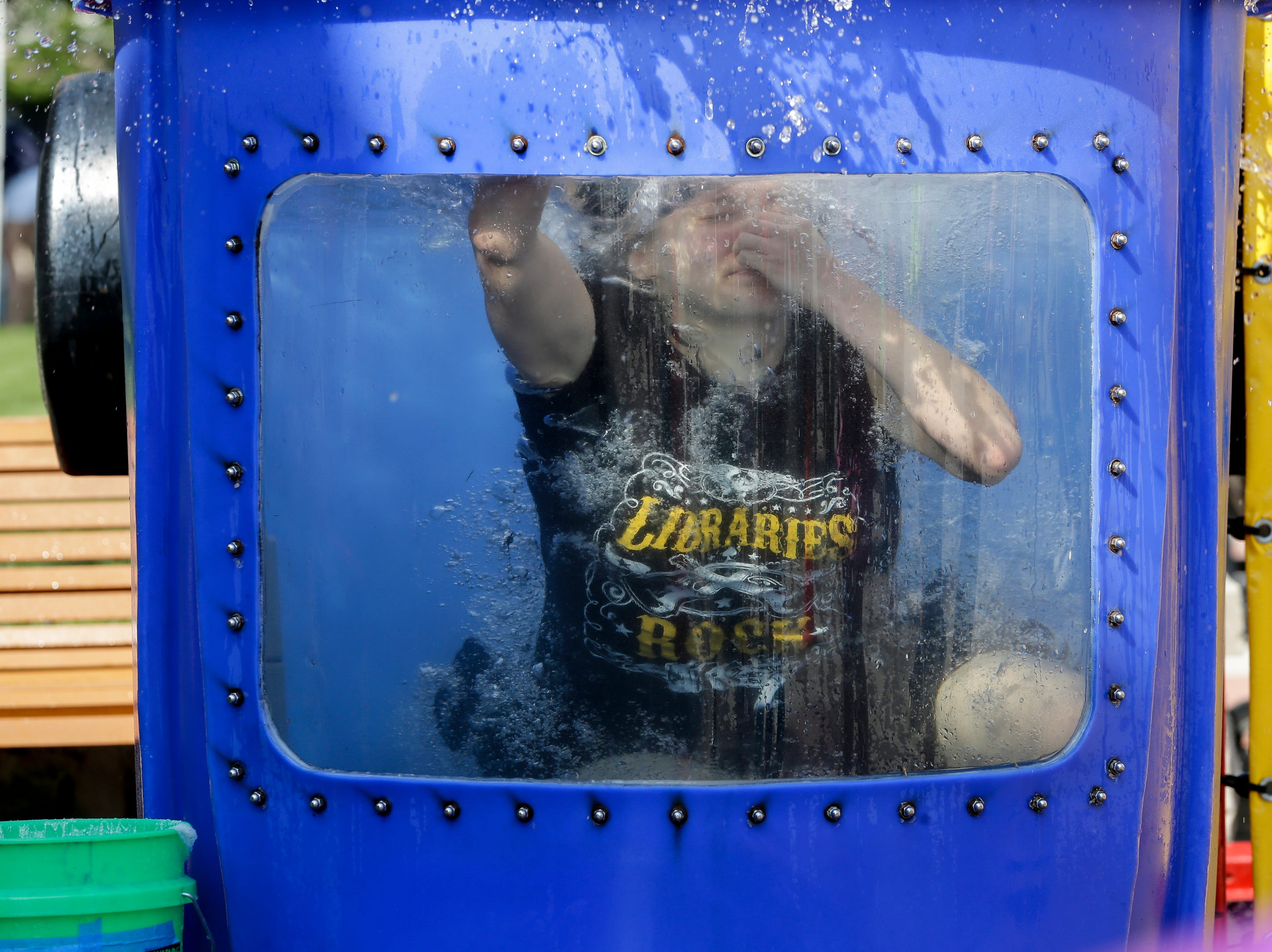 Library youth services manager Julia Lee goes under in the dunk tank at the library carnival Saturday, August 4, 2018, in Manitowoc, Wis. Josh Clark/USA TODAY NETWORK-Wisconsin