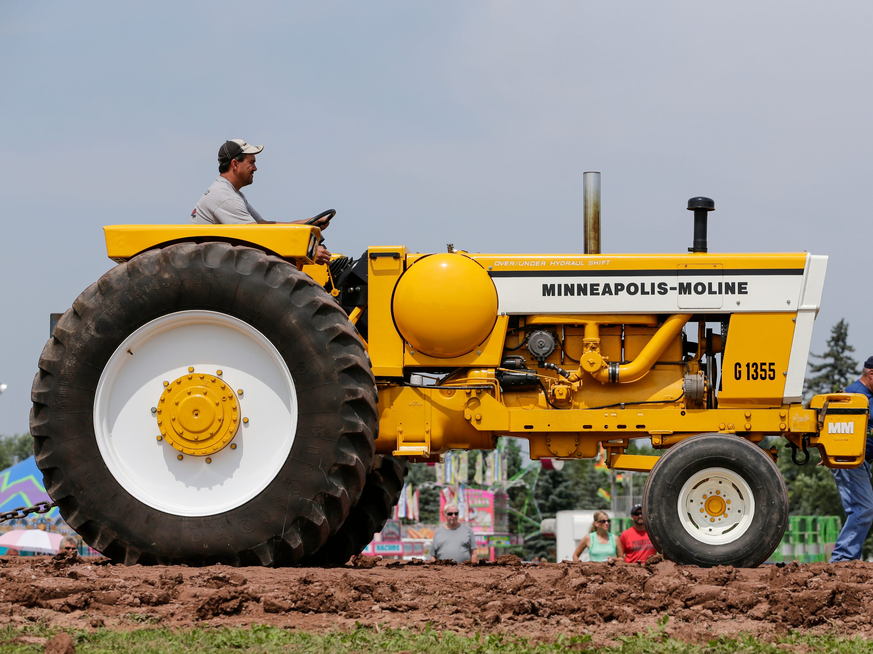 Randy Walecka of Kewaunee takes his Minneapolis-Moline down the tractor pull course during Mishicot Riverfest Saturday, August 4, 2018, in Mishicot, Wis. Josh Clark/USA TODAY NETWORK-Wisconsin