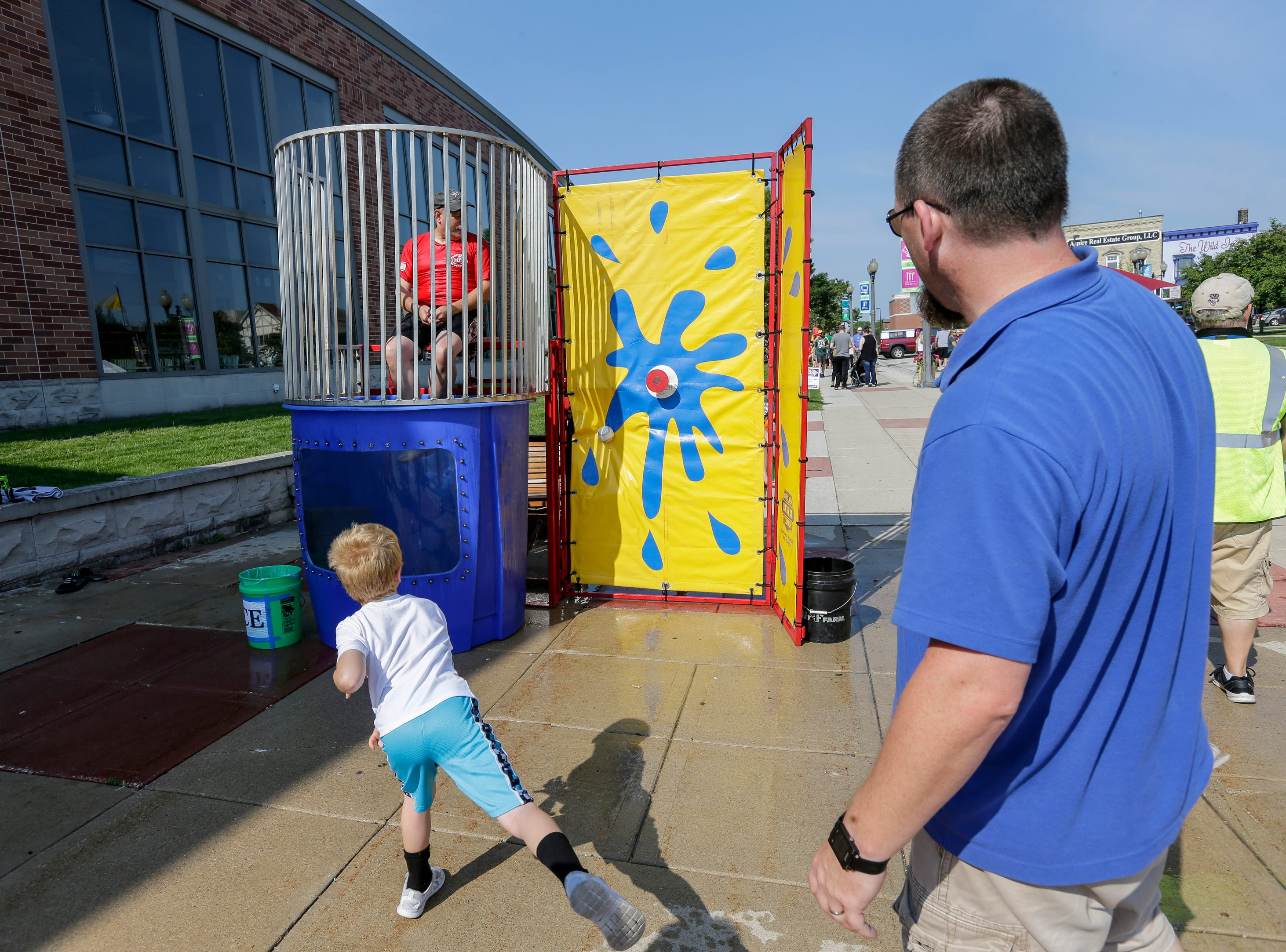 Kids line up for their shot at the dunk tank during the library carnival Saturday, August 4, 2018, in Manitowoc, Wis. Josh Clark/USA TODAY NETWORK-Wisconsin