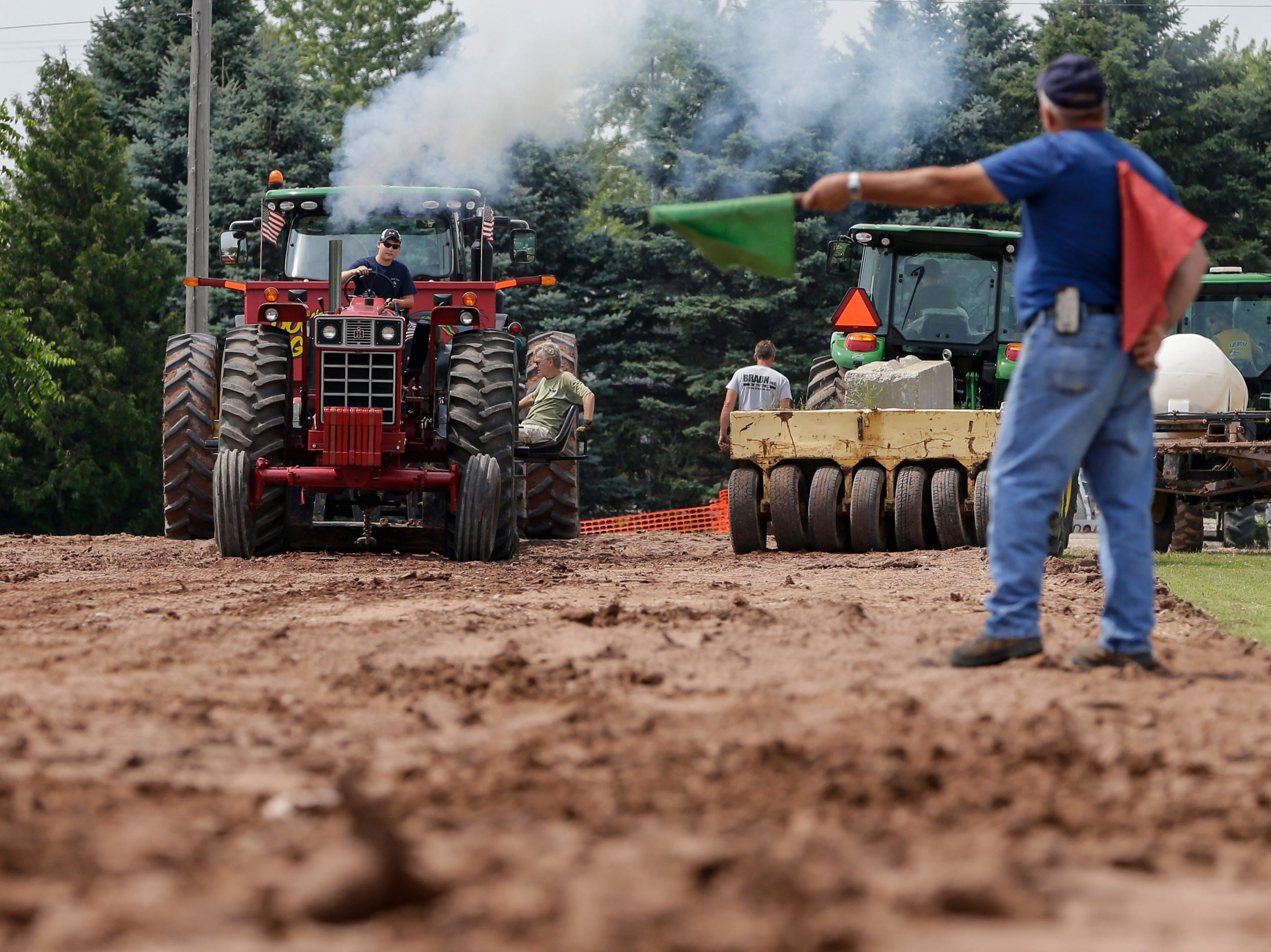 Kaeden Fisher of Newton starts his pull on his International Harvester during the tractor pull at Mishicot Riverfest Saturday, August 4, 2018, in Mishicot, Wis. Josh Clark/USA TODAY NETWORK-Wisconsin