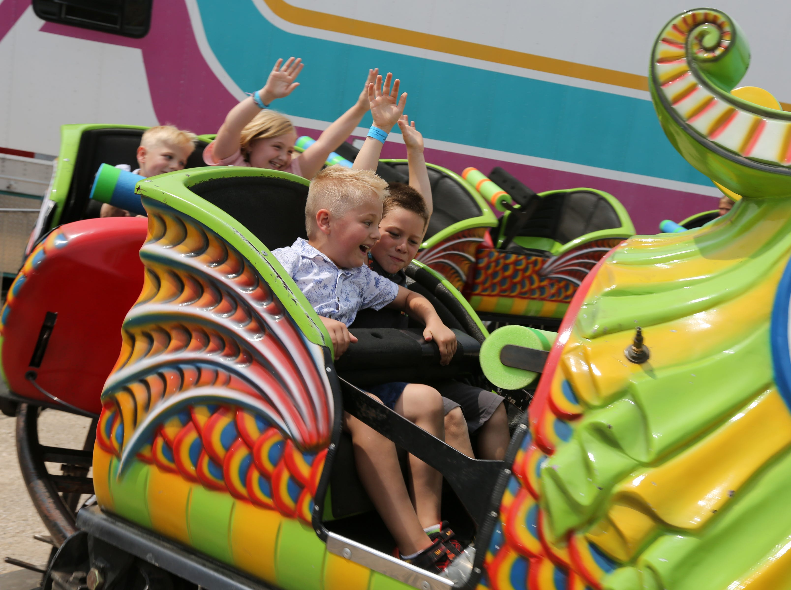 Kids ride a roller coaster during Mishicot Riverfest Saturday, August 4, 2018, in Mishicot, Wis. Josh Clark/USA TODAY NETWORK-Wisconsin