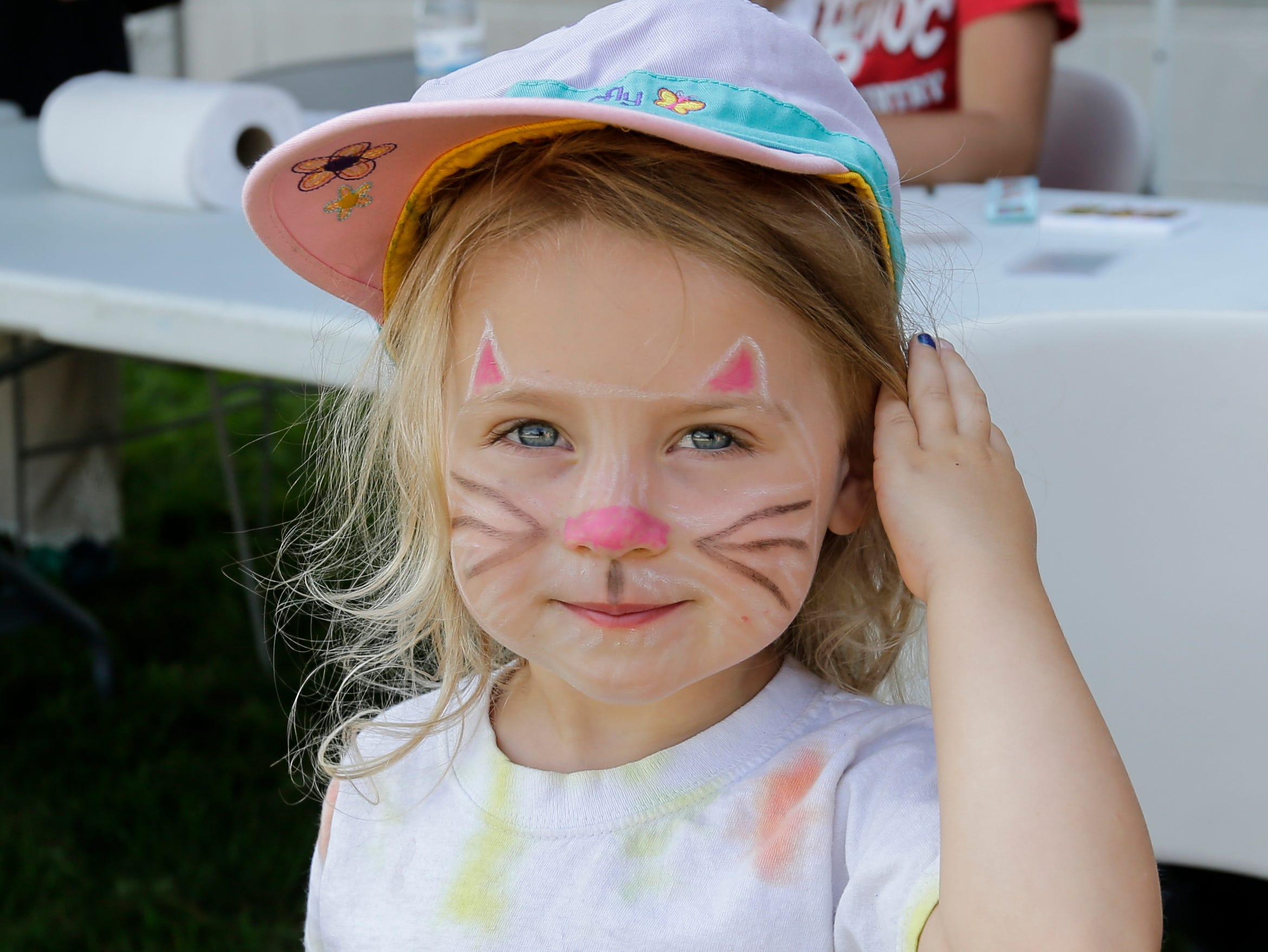 Isabelle Stoeger, 3, shows off her cat face painting at the library carnival Saturday, August 4, 2018, in Manitowoc, Wis. Josh Clark/USA TODAY NETWORK-Wisconsin