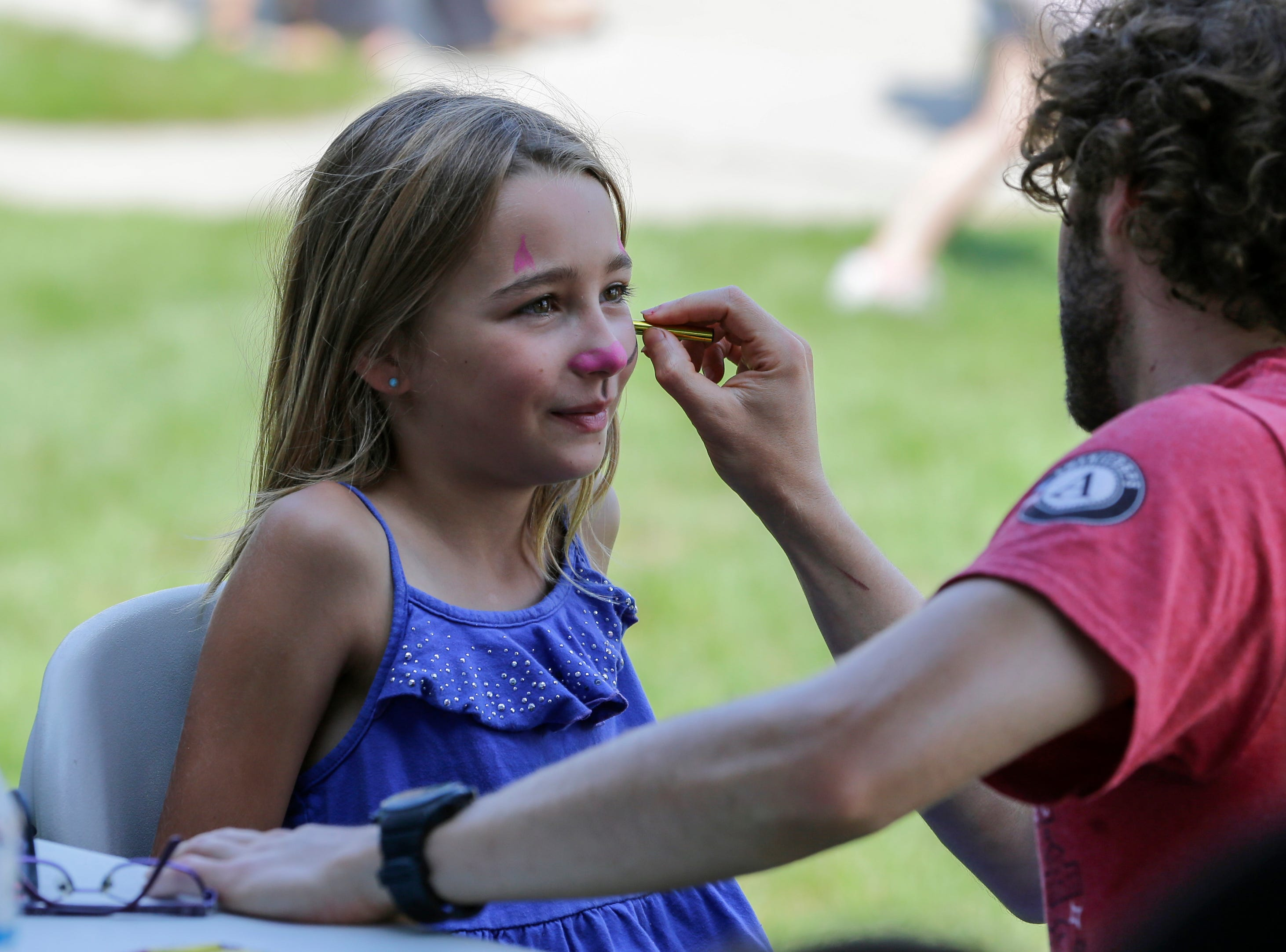 Face painting at the library carnival Saturday, August 4, 2018, in Manitowoc, Wis. Josh Clark/USA TODAY NETWORK-Wisconsin