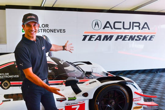 Helio Castroneves shows off the No. 7 Acura prototype he shares with Ricky Taylor.