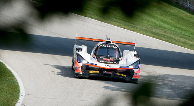 Helio Castroneves enters the Carousel on Saturday during practice for the Continental Tire Road Race Showcase at Road America in Elkhart Lake.